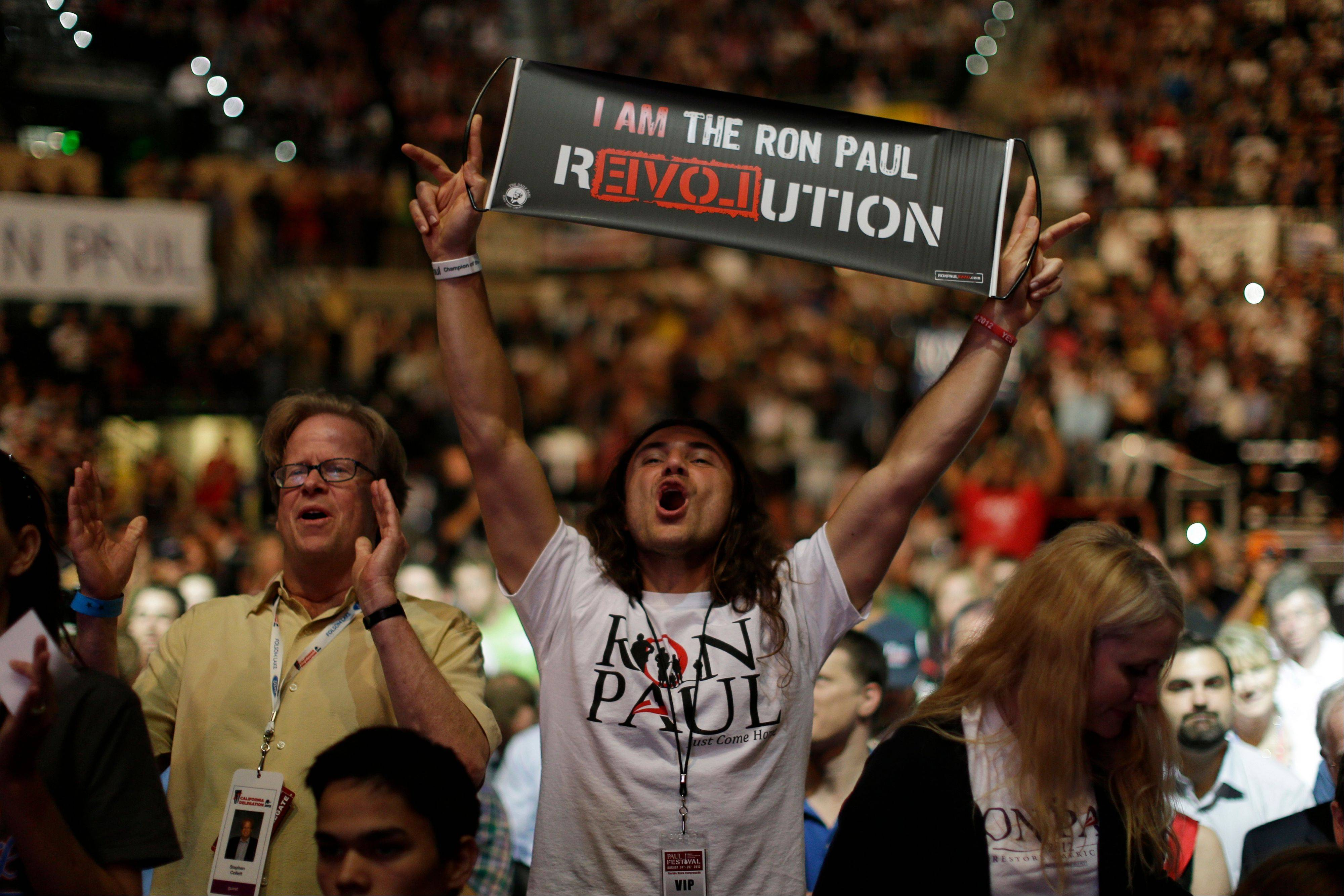 Vreth Liberty Zatikyan from Santa Monica, Calif., shows his support for Rep. Ron Paul, during a rally at the University of South Florida Sun Dome on the sidelines of the Republican National Convention in Tampa, Fla., Sunday.