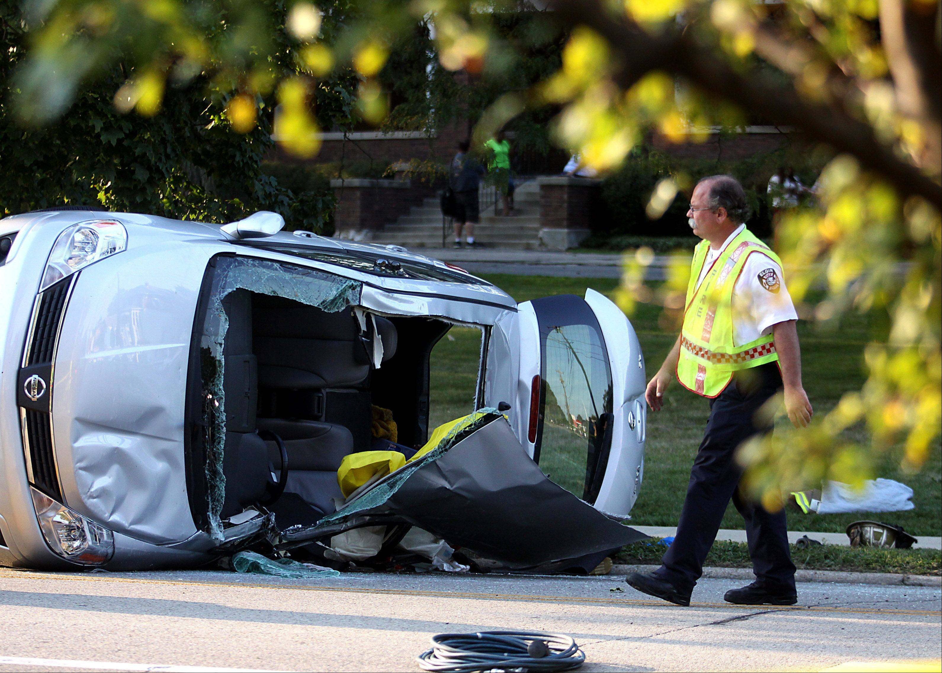 Patrick Kunzer/pkunzer@dailyherald.comElgin fire and police personnel responded to a crash which involved a minivan on its side along Larkin Avenue near Melrose Avenue on Tuesday evening.