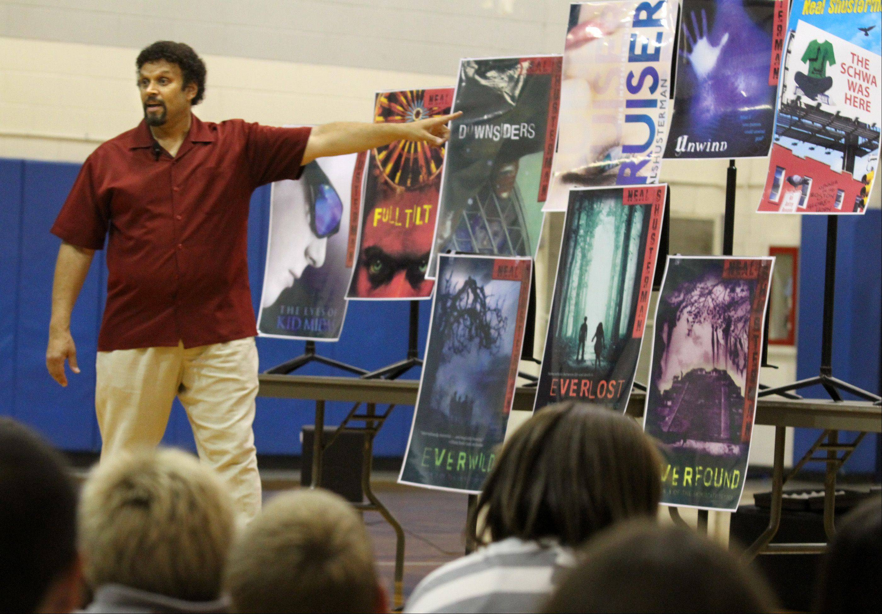 "Neal Shusterman, author of the popular young adult science fiction novel, ""Unwind,"" speaks to students Tuesday at Plum Grove Junior High in Rolling Meadows. His appearance coincided with the release of the sequel, ""UnWholly."""
