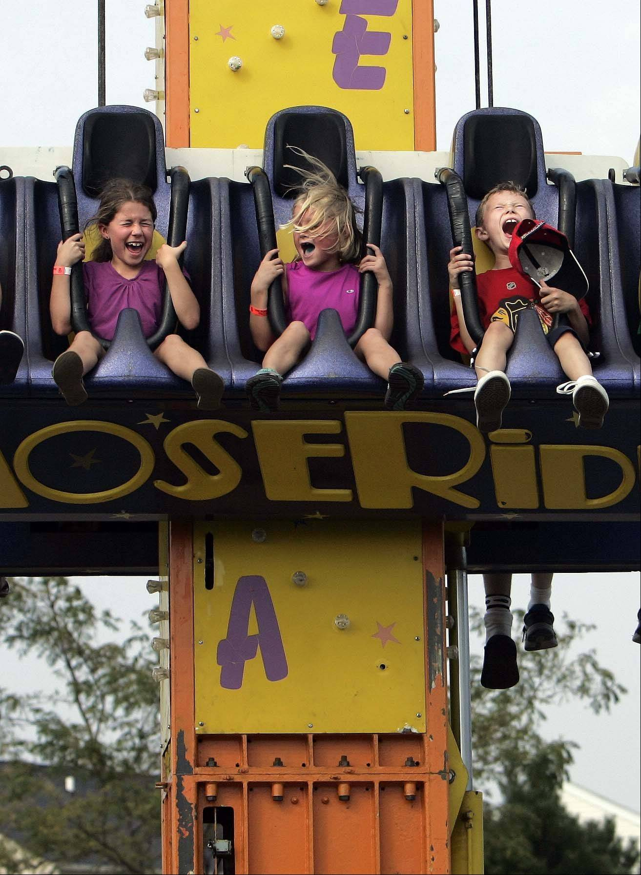 From left, Kaia Huston, 8, of Huntley; Lily Landoch, 7, of Lake in the Hills and Caden Cotton, 8, of Huntley let out a scream as they drop on the one of the rides at last year's Lake in the Hills Summer Sunset Festival. This year's festival opens Friday, Aug. 31 and runs through Sunday, Sept. 2.