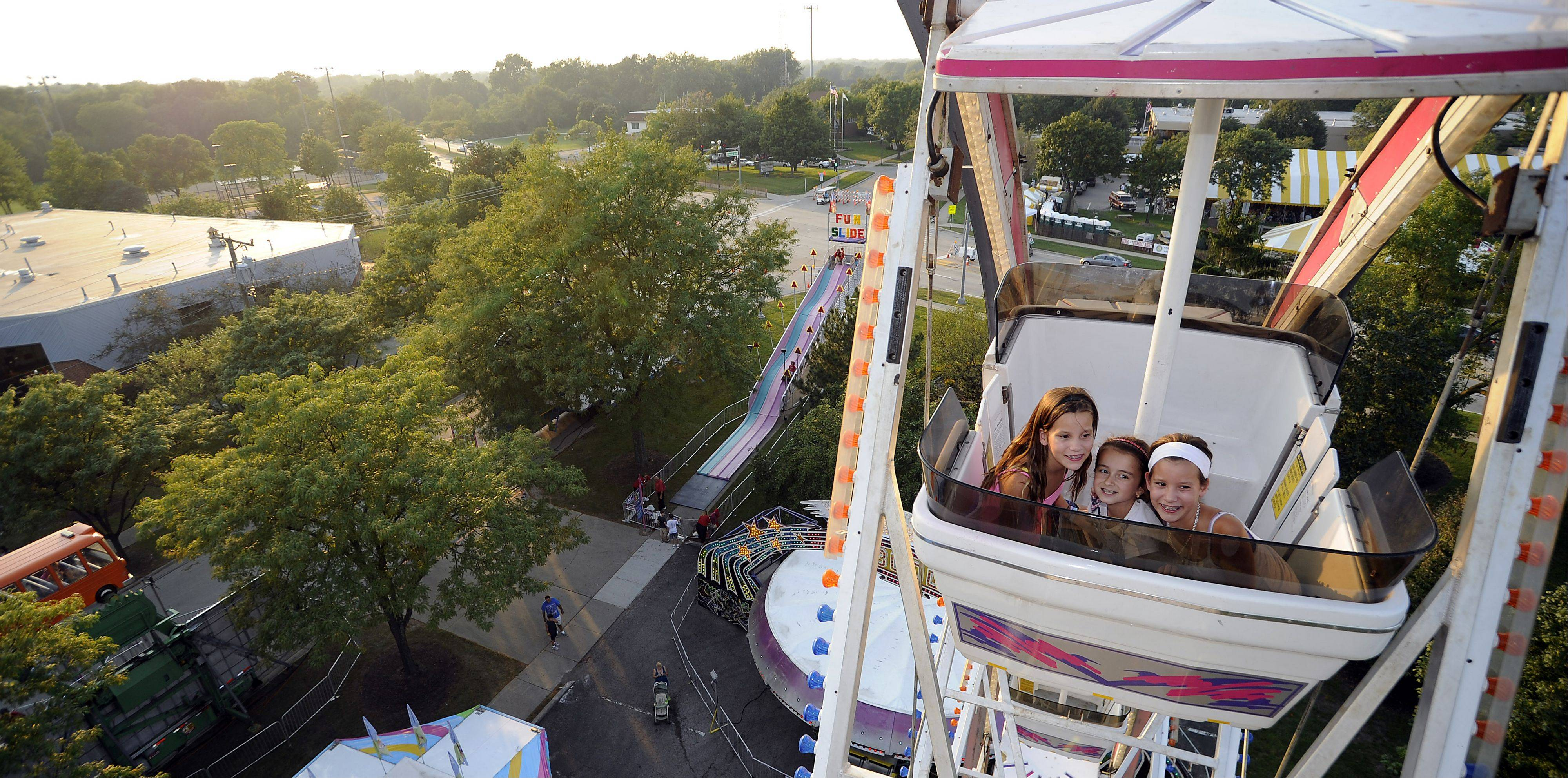 Kids enjoy the Ferris wheel at the 2011 carnival.