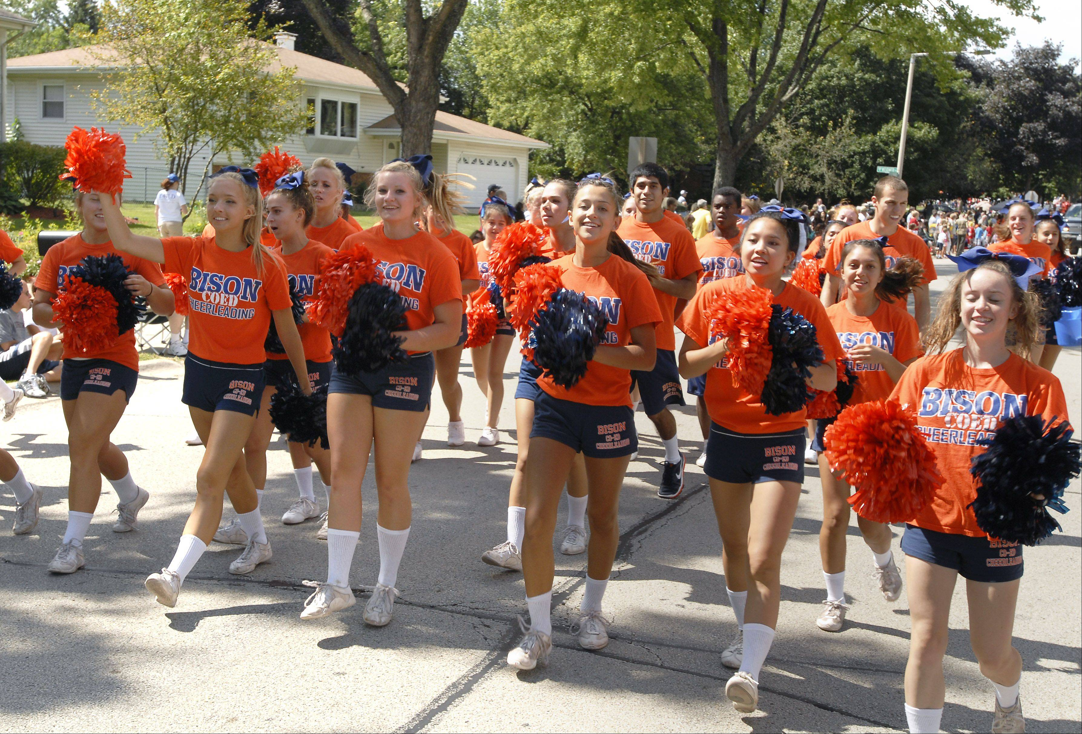 Bison cheerleaders follow the Buffalo Grove High School marching band at last year's Buffalo Grove Days parade.