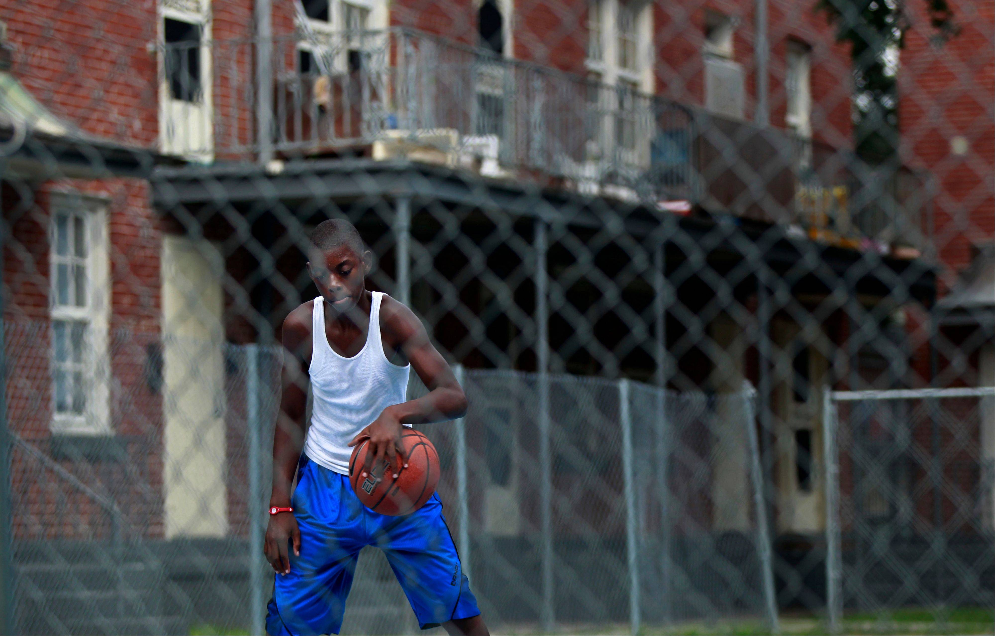 Johnny Anderson, 12, plays basketball in the Iberville housing projects, which are slated to be torn down.