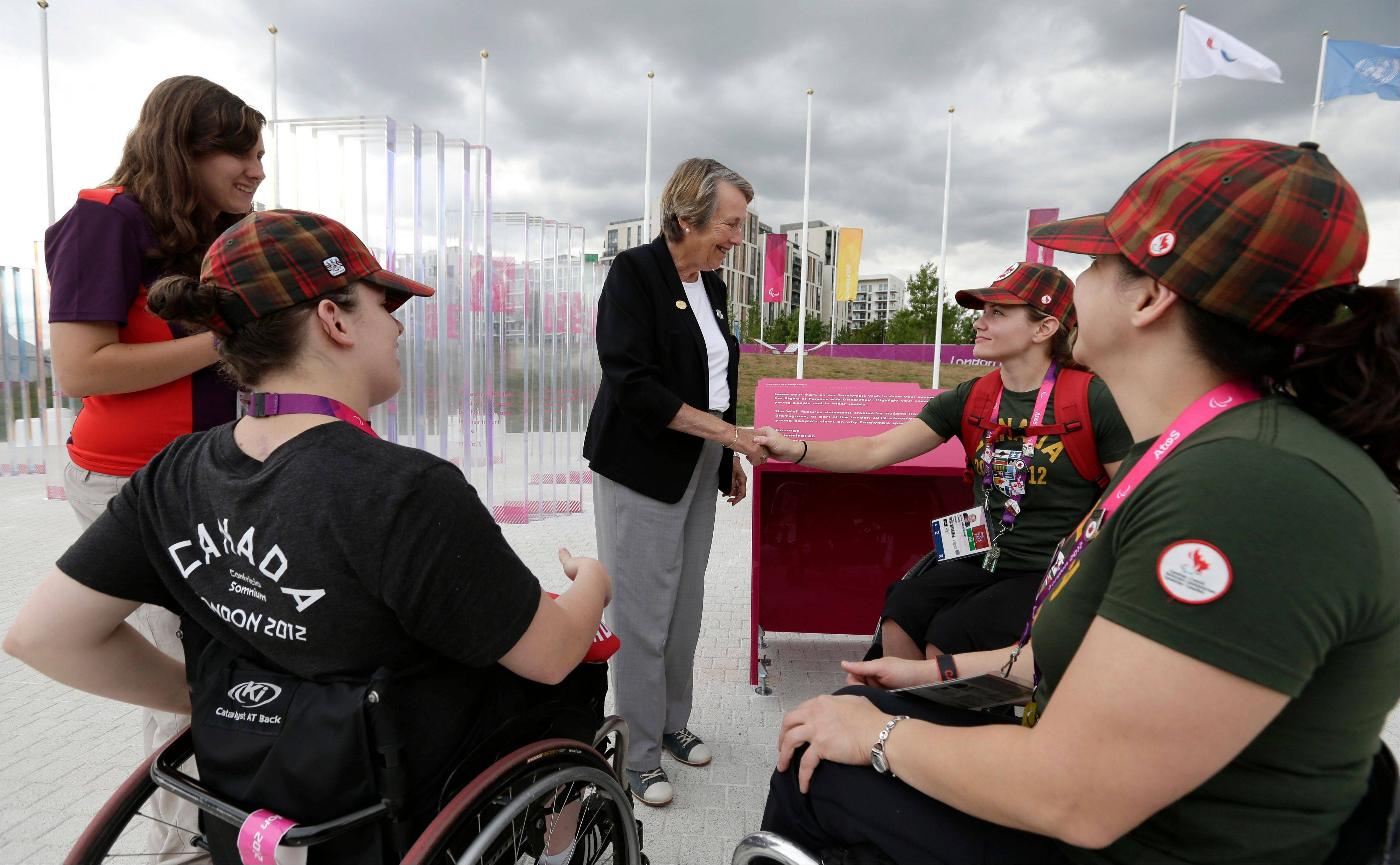 Eve Loeffler, daughter of Paralympic Games founder Ludwig Guttman, meets members of the Canadian Paralympic women's wheelchair basketball team, at the athletes village at th