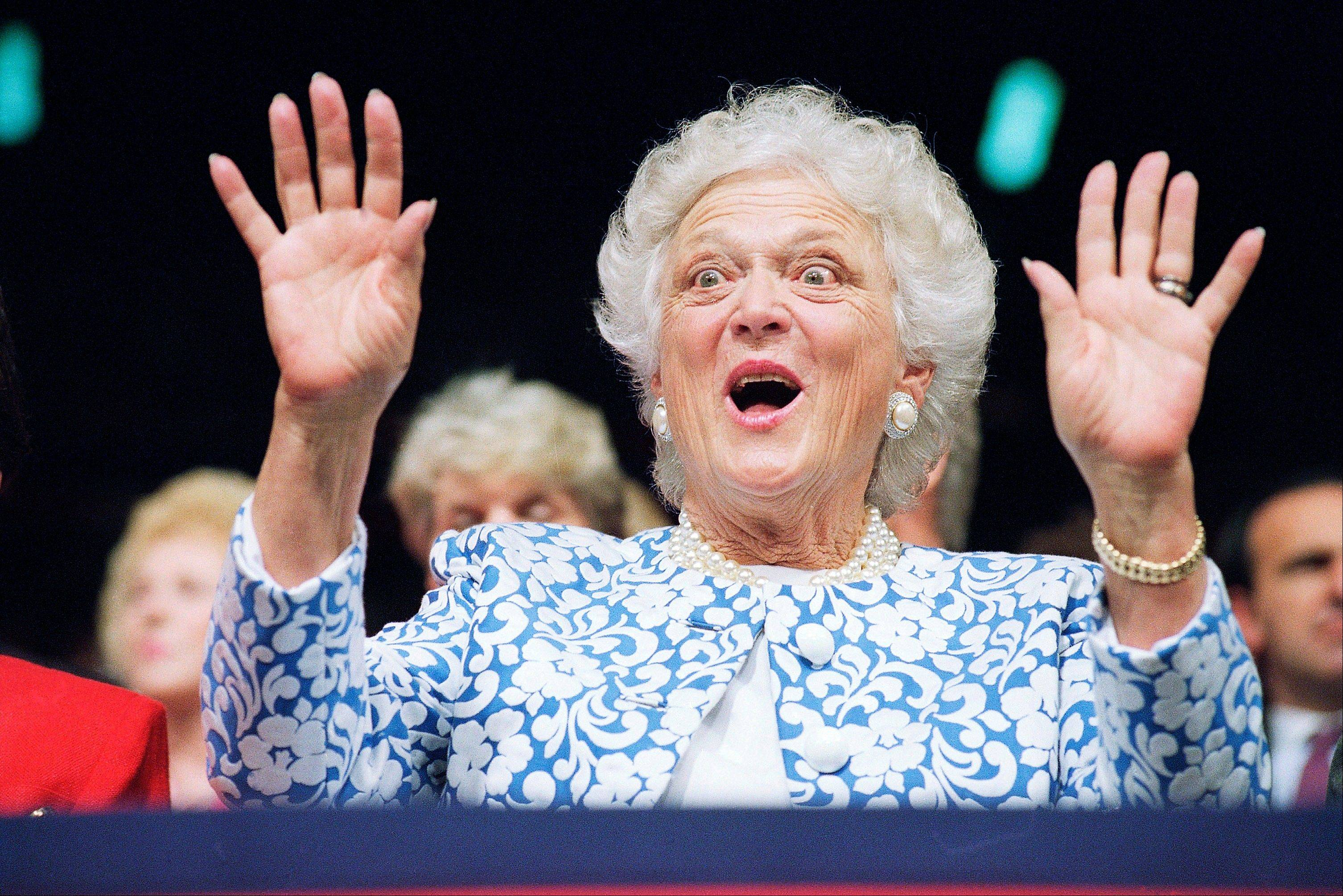 In this Aug. 18, 1992, file photo, first lady Barbara Bush reacts to Sen. Phil Gramm, who delivered the keynote address to the Republican National Convention at the Houston Astrodome.
