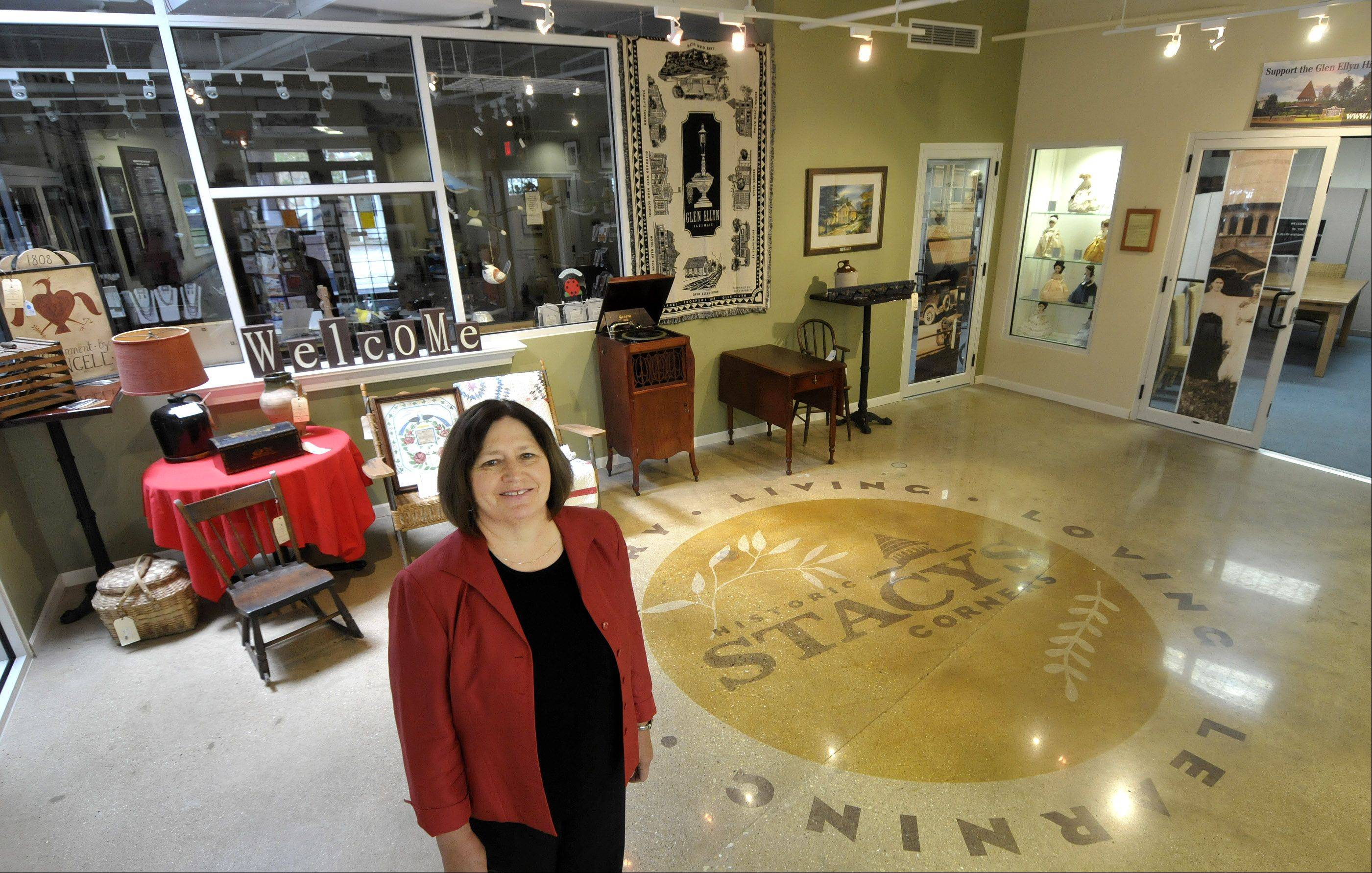 Jan Shupert-Arick, the new executive director of the Glen Ellyn Historical Society, is looking for more ways to share Glen Ellyn's rich history with the community, including having changing exhibits in the lobby of the Glen Ellyn History Center.