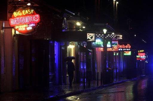 A deserted Bourbon Street in the French Quarter is shown as Hurricane Isaac makes landfall Tuesday, Aug. 28, 2012, in New Orleans. Hurricane Isaac made landfall south of New Orleans Tuesday night.