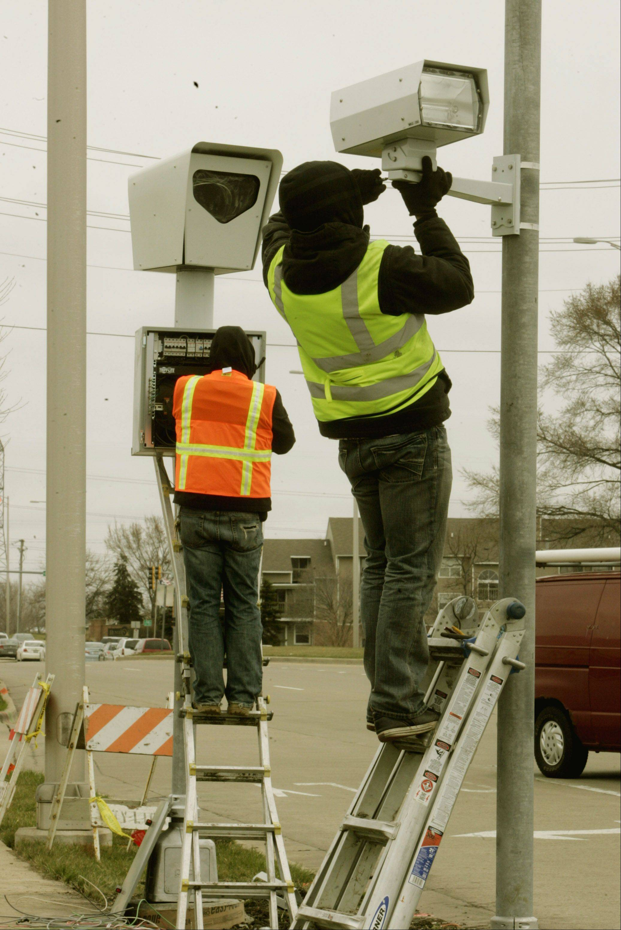 We often gripe about seeing these red-light cameras throughout the suburbs, but some suburban schools tout surveillance cameras that let parents log on to a website to watch their children.