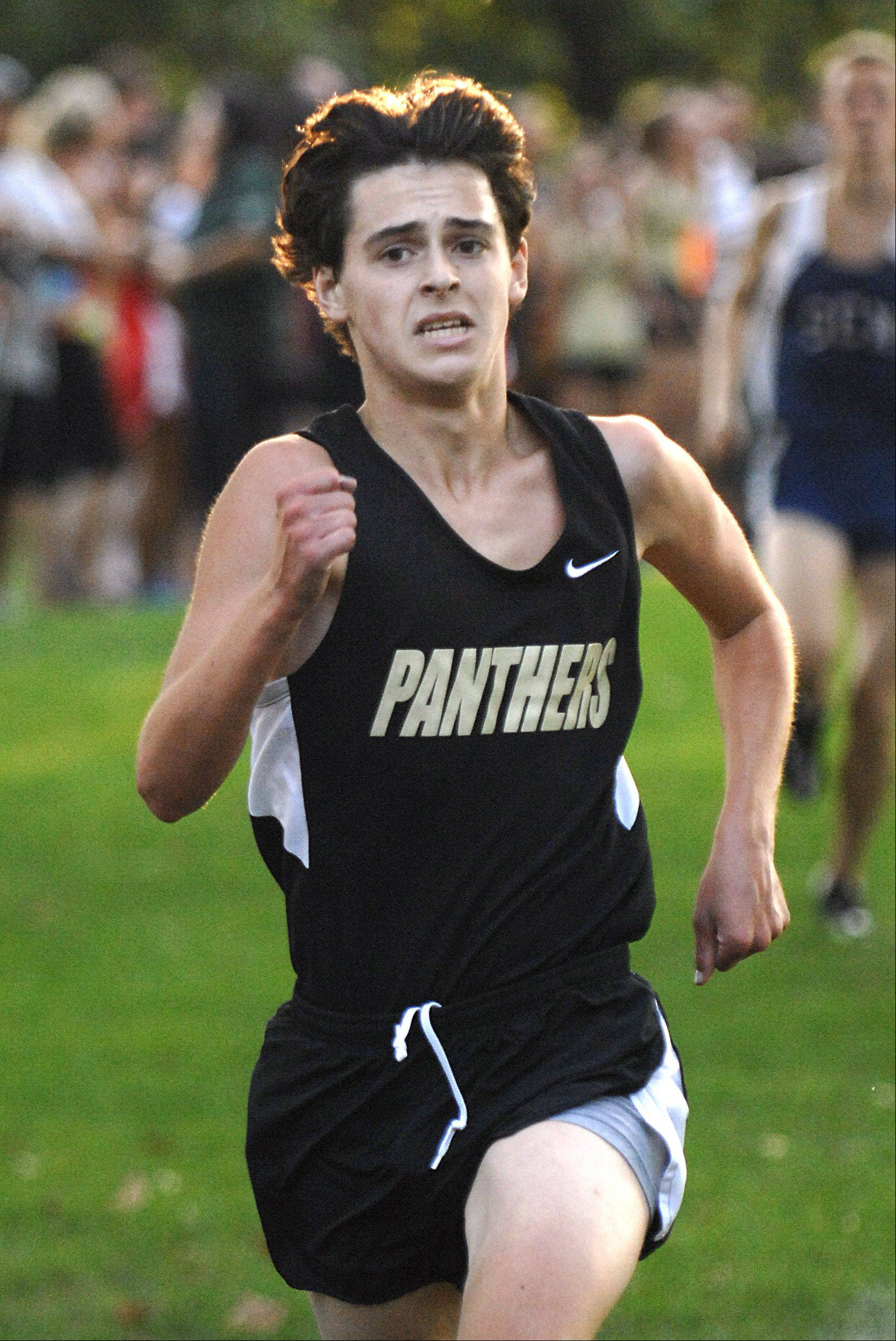 Glenbard North's Tyler Dixon finishes first for his team in the Elgin City Classic at Lords Park on Thursday, August 28.