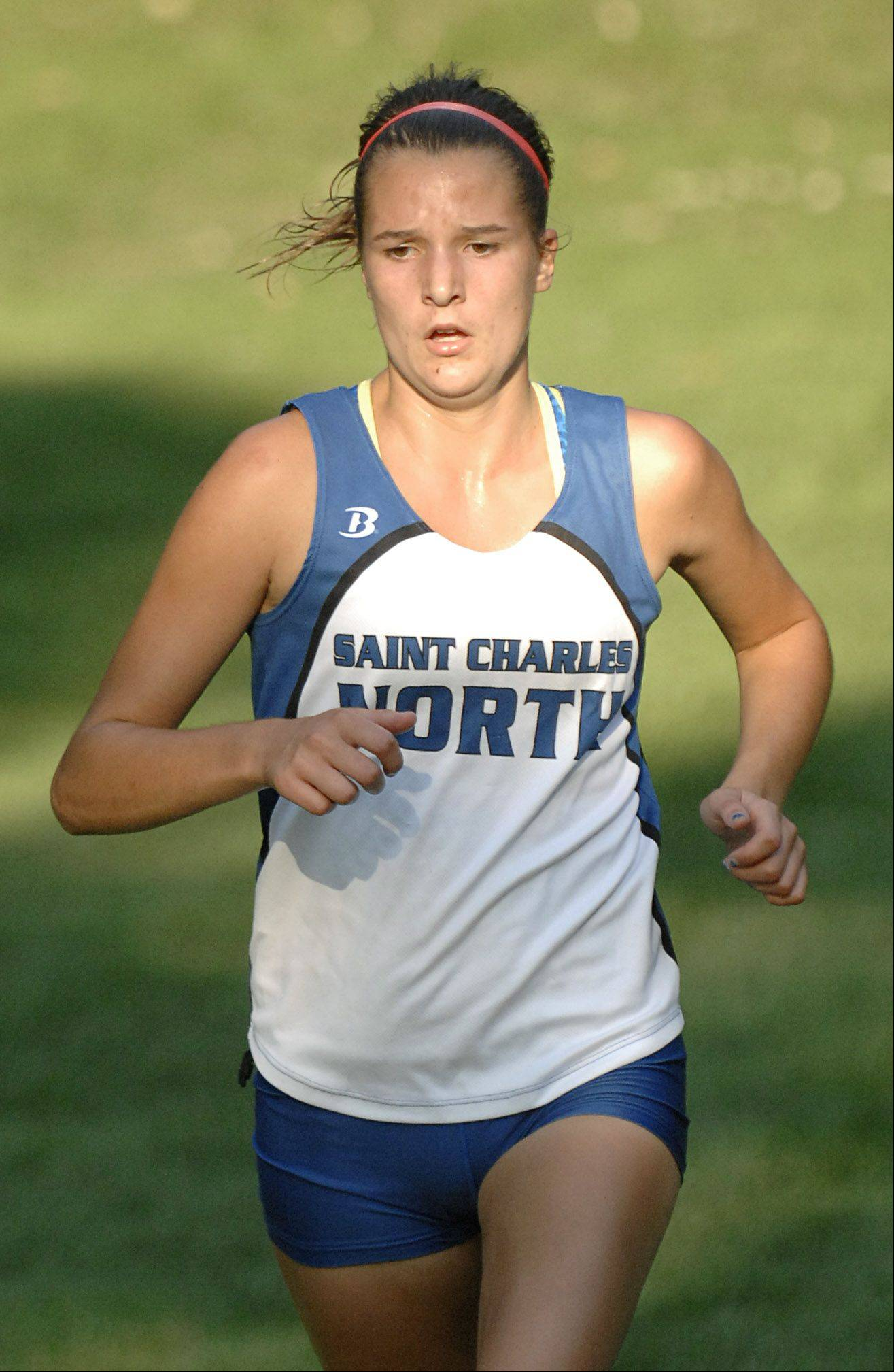 St. Charles North's Ashley England takes second in girls varsity in the Elgin City Classic at Lords Park on Thursday.