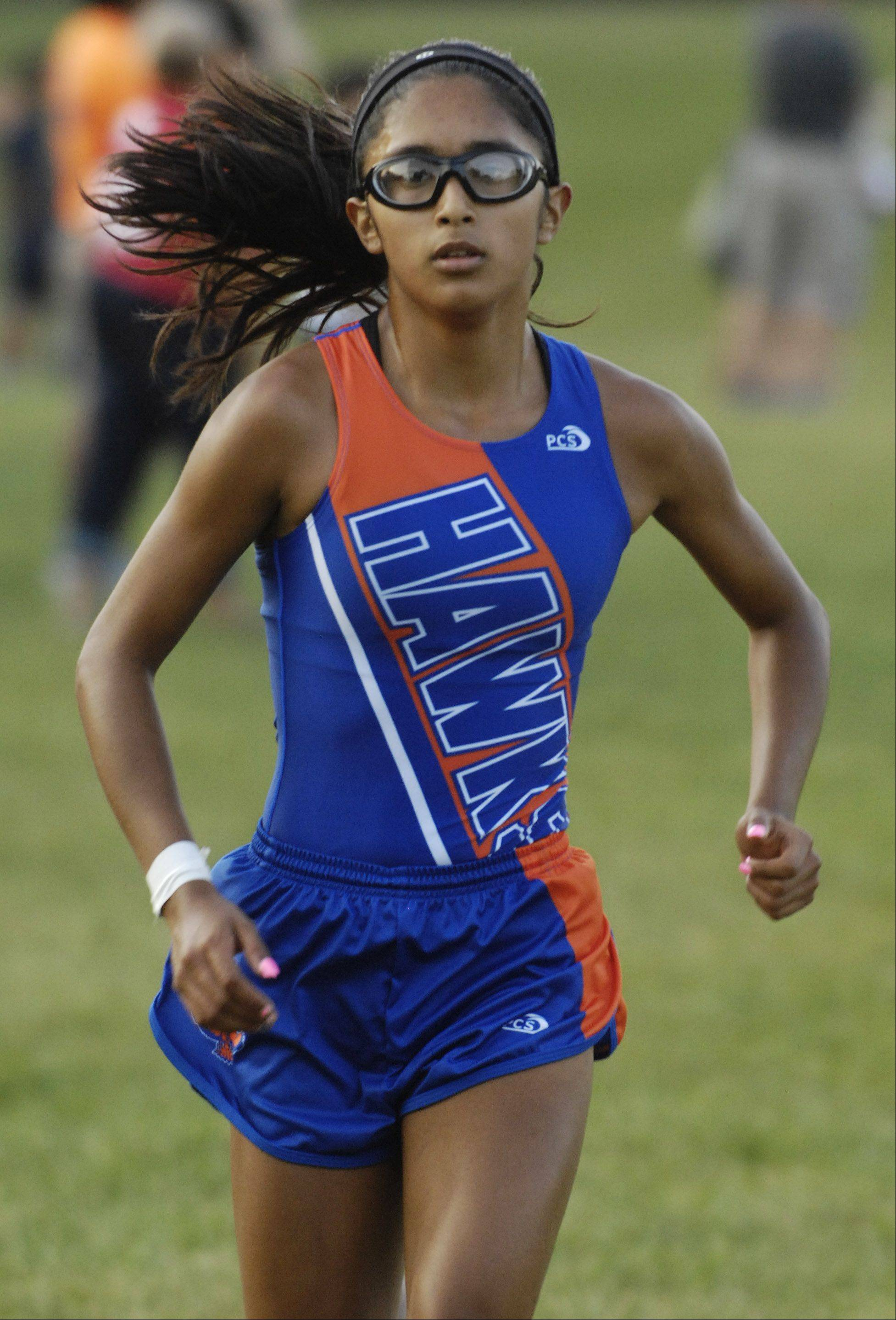 Hoffman Estates' Alondra Aguirre wins Tuesday's cross country meet with Prospect at Barrington Pond.