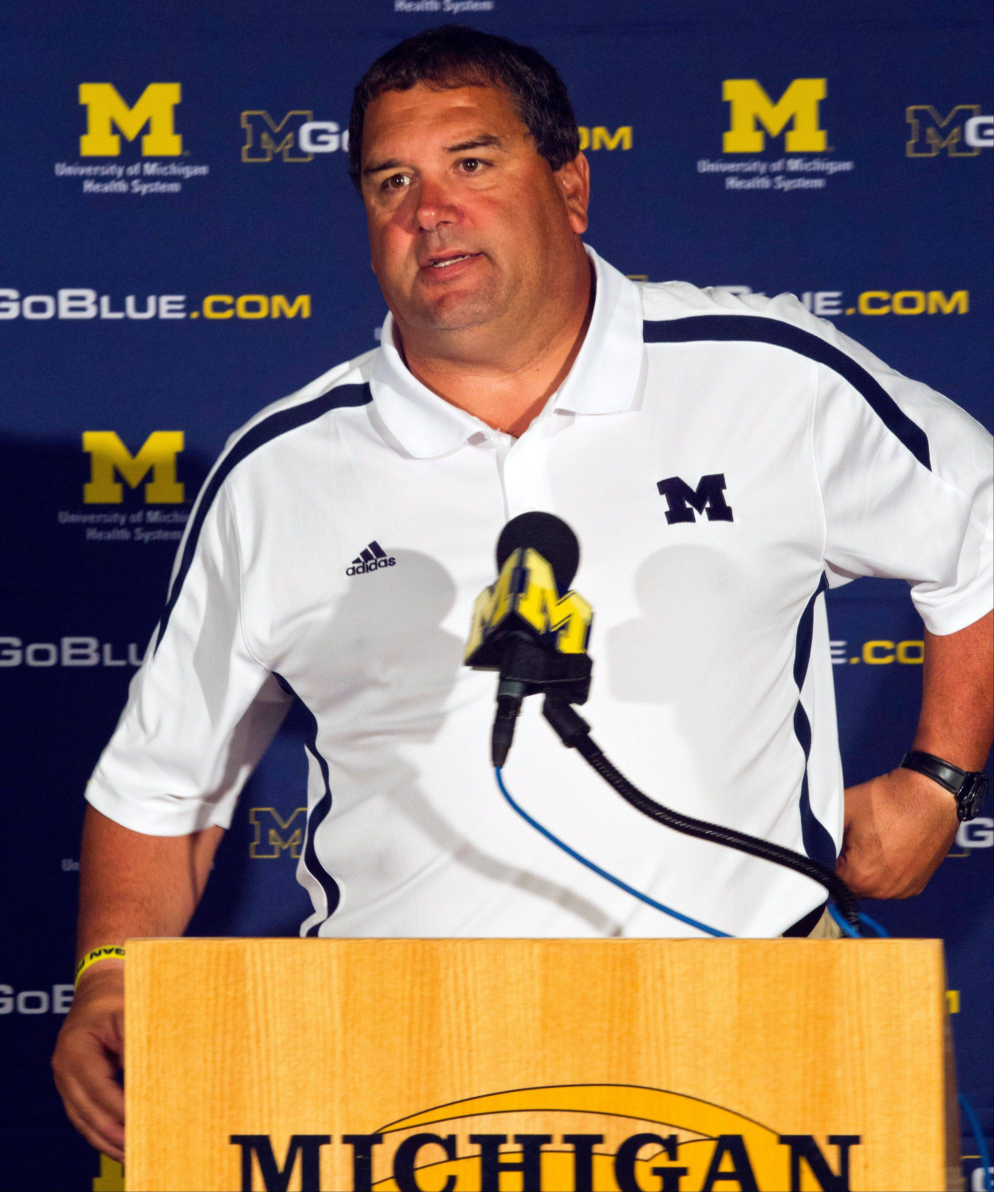 Michigan head coach Brady Hoke and the Wolverines play Alabama for just the fourth time on Saturday at Cowboys Stadium in Arlington, Texas, despite having combined for 1,709 wins and 25 national titles.