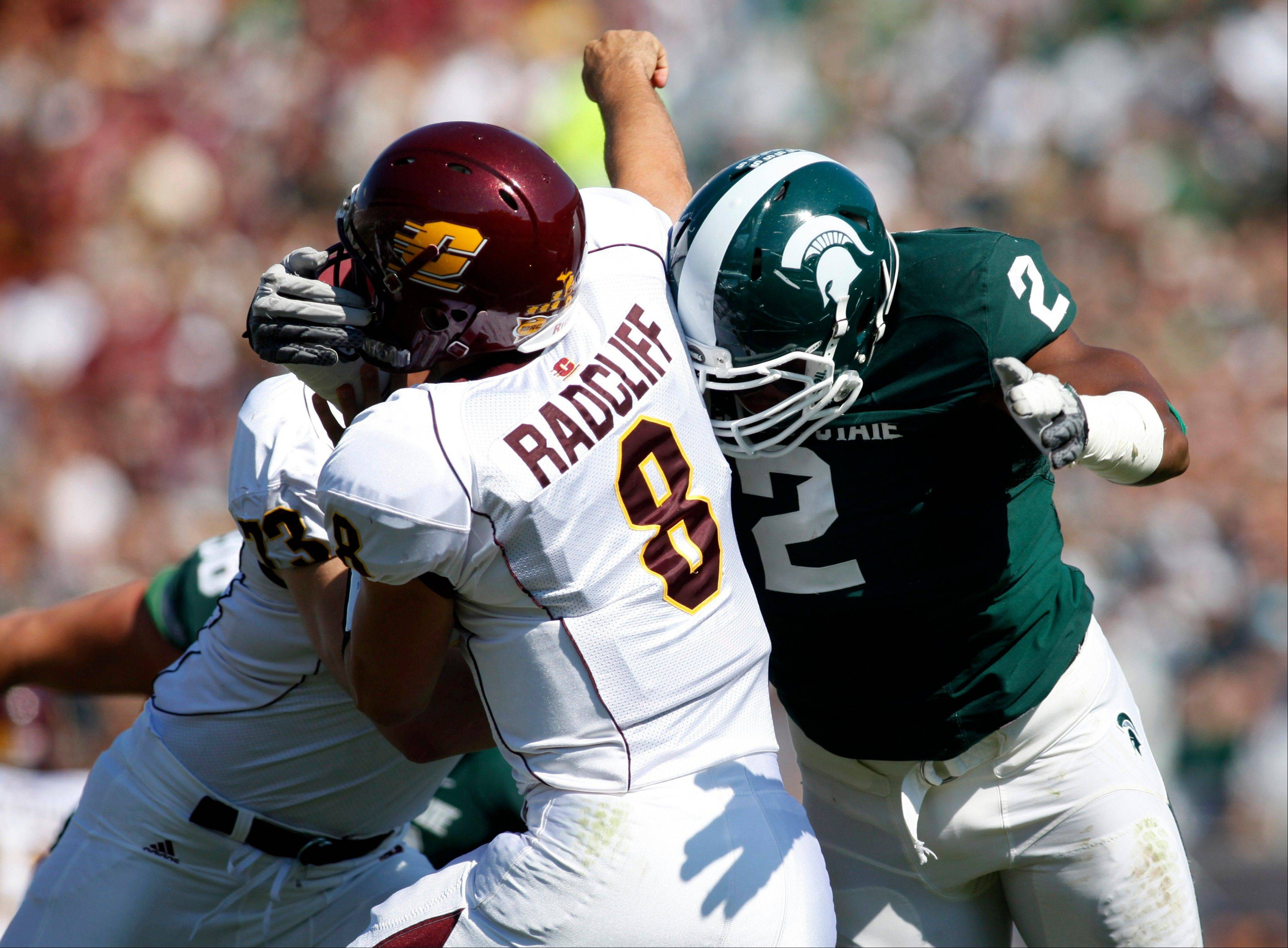 Michigan State's William Gholston hits Central Michigan quarterback Ryan Radcliff last season. The Spartans open the season against Boise State Friday night.