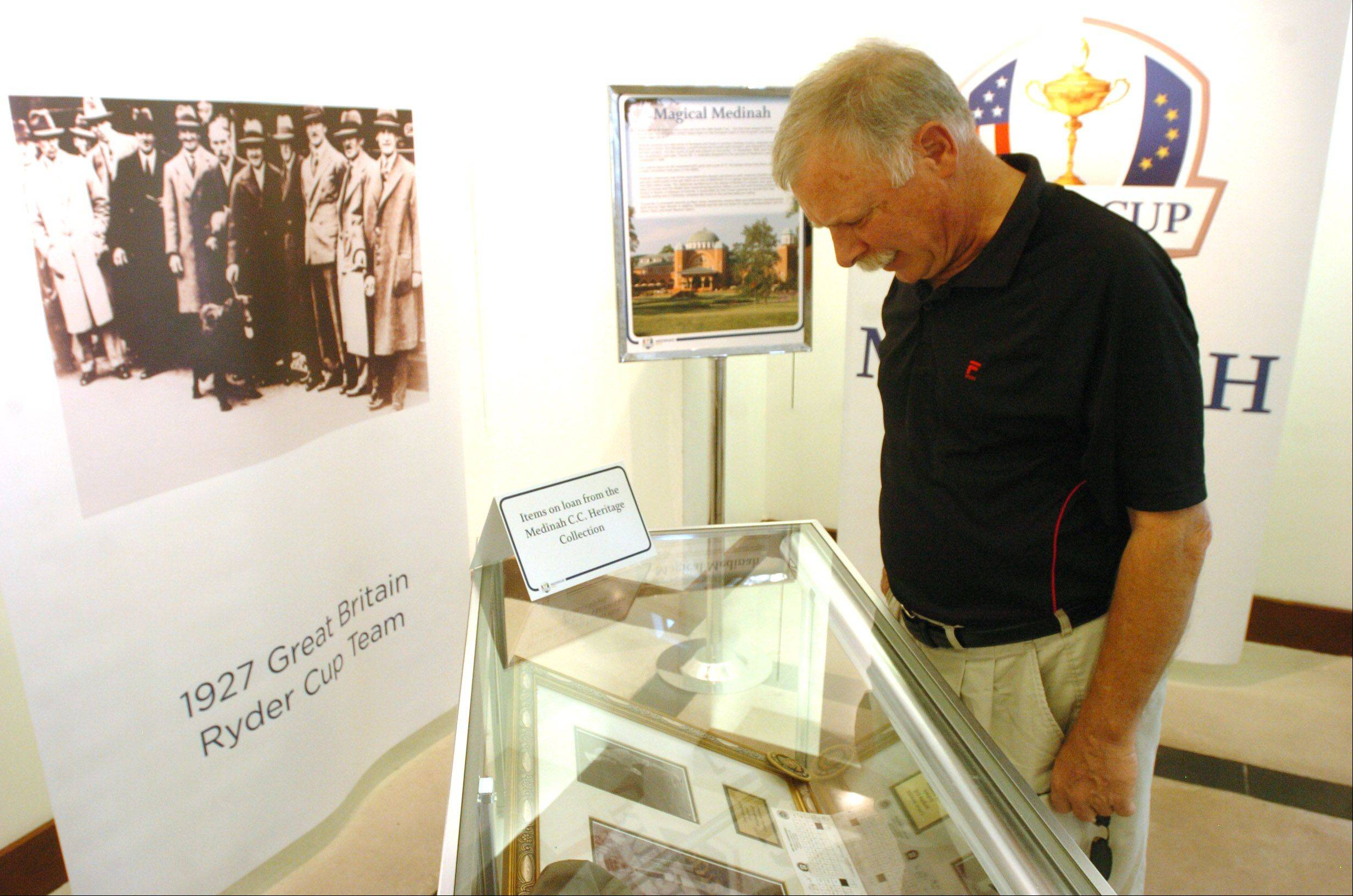 Trent Richards of Roselle checks out the historical data and items on display at the Ryder Cup Exhibit at Oakbrook Center.