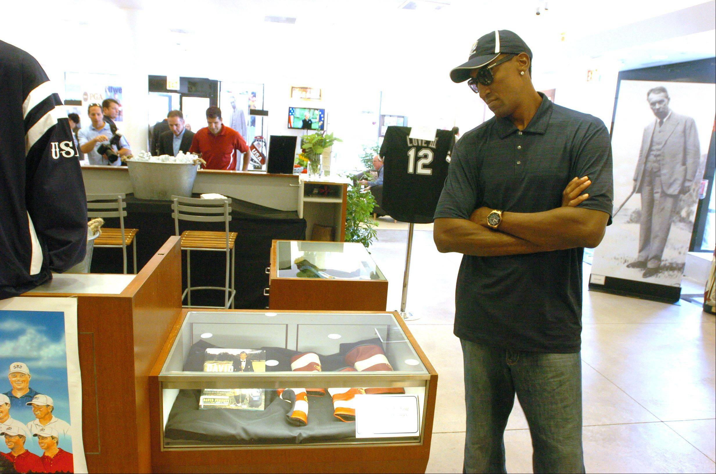 Scottie Pippen looks around the Ryder Cup Exhibit at Oakbrook Center.