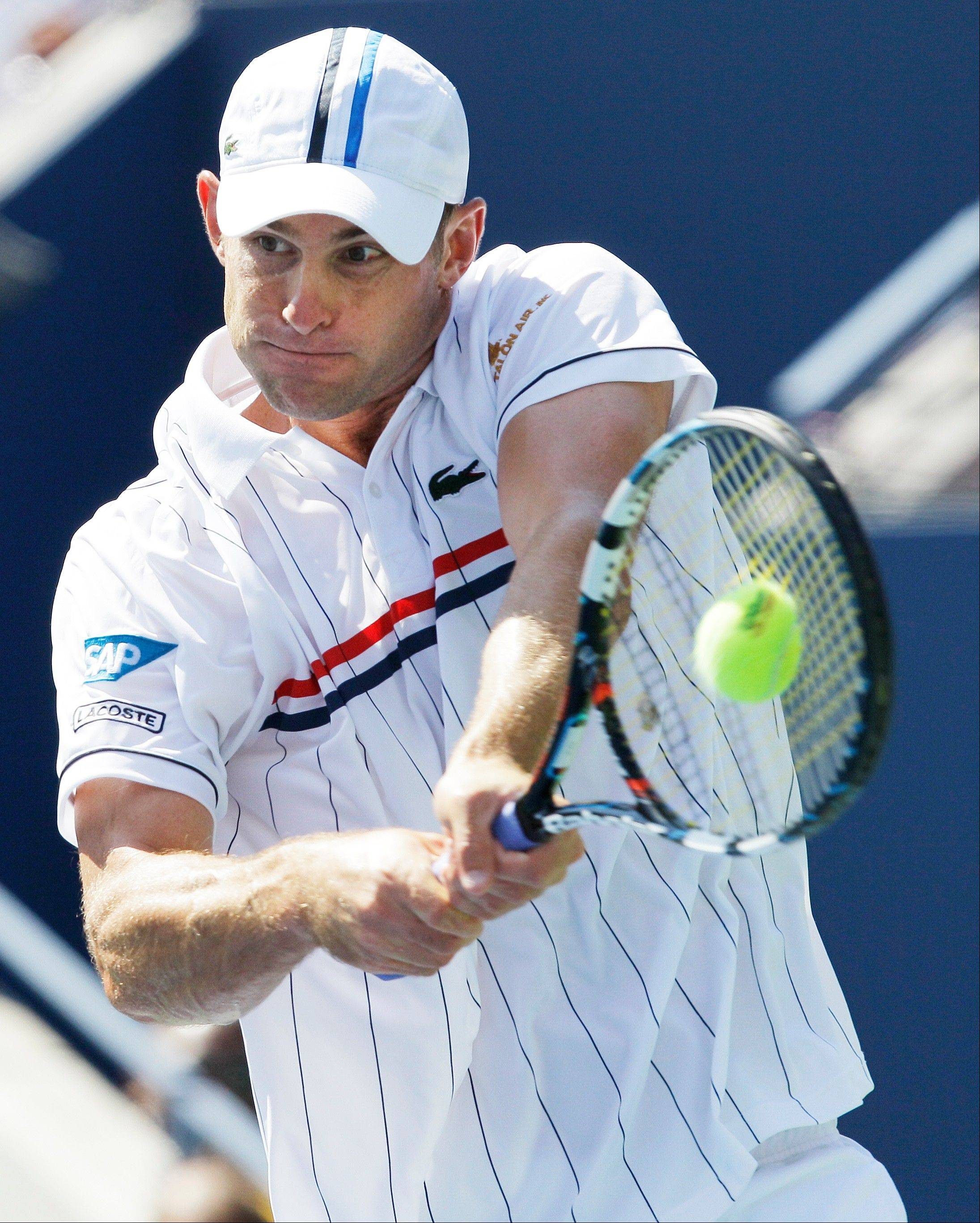 Andy Roddick returns a shot to Rhyne Williams Tuesday during the first round at the 2012 US Open tennis tournament.