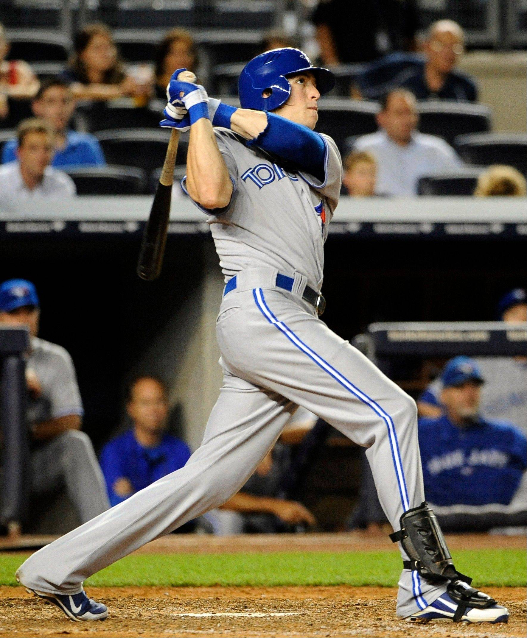 The Blue Jays' Colby Rasmus hits a three-run home run in the ninth inning Monday night in New York.