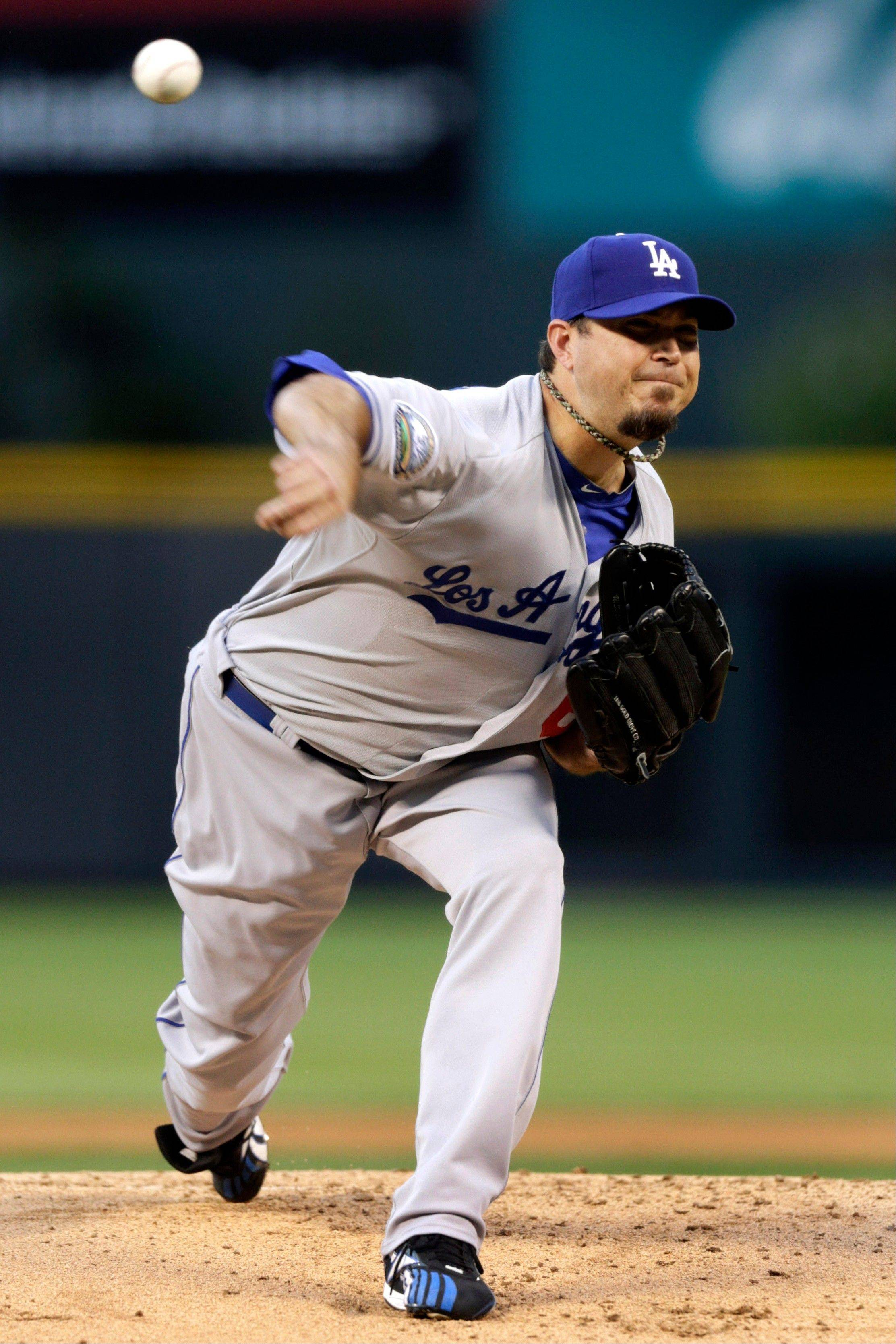 Los Angeles Dodgers starting pitcher Josh Beckett allowed three runs over 5 2-3 innings Monday night in Denver.
