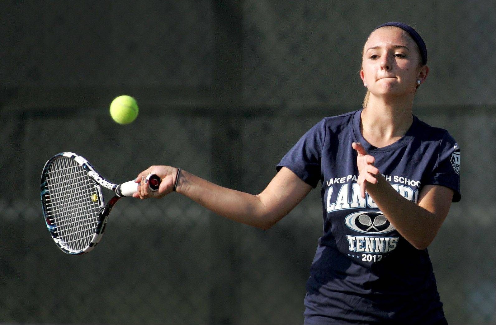 Lake Park's Claudia Kazmirak returns a shot in her singles match against Glenbard South in Monday's tennis meet in Glen Ellyn.