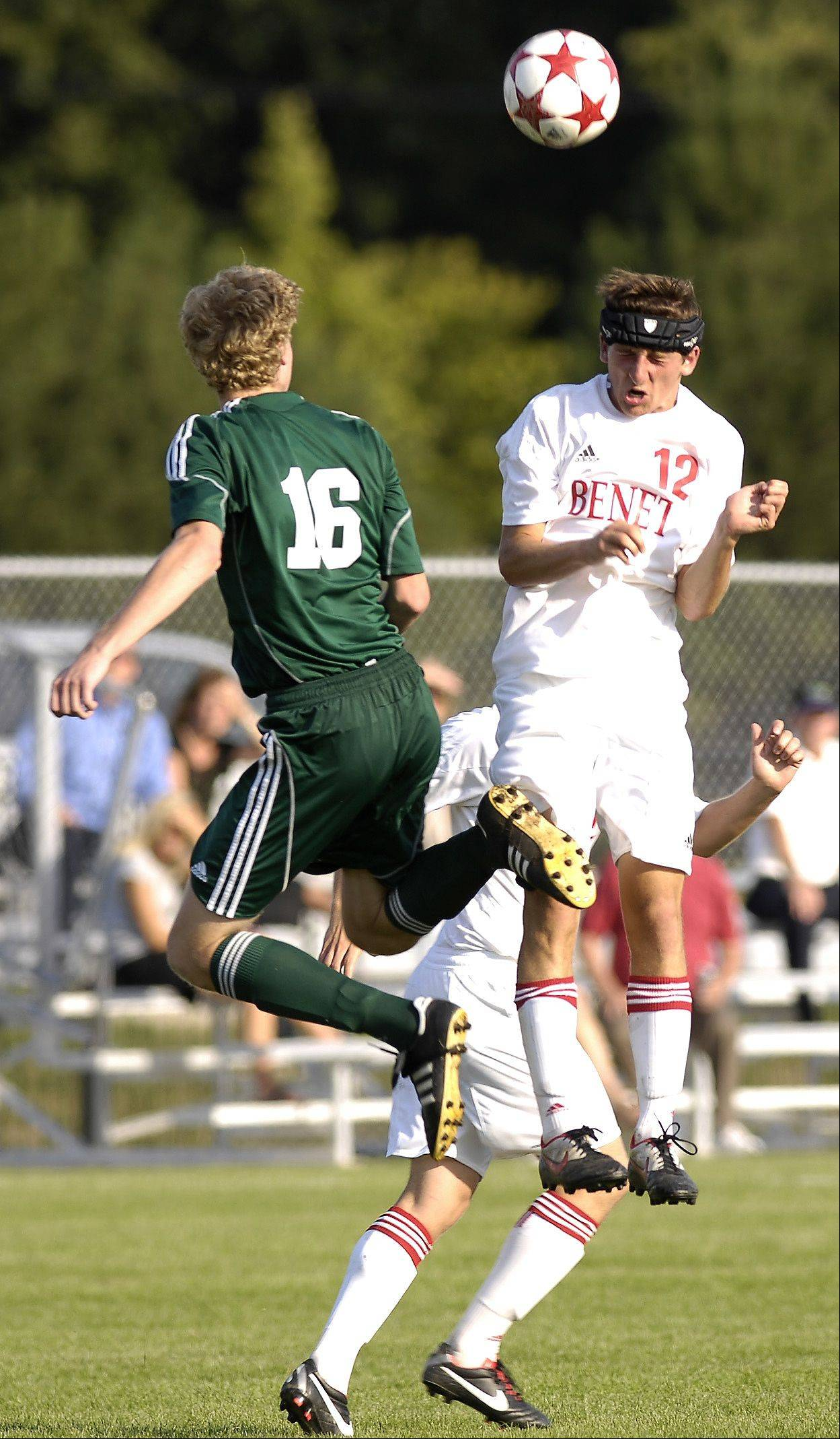 Waubonsie Valley's Jack Cordes and Benet's Kyle Kenagy work for control of the ball during Thursday's boy soccer action in Lisle.