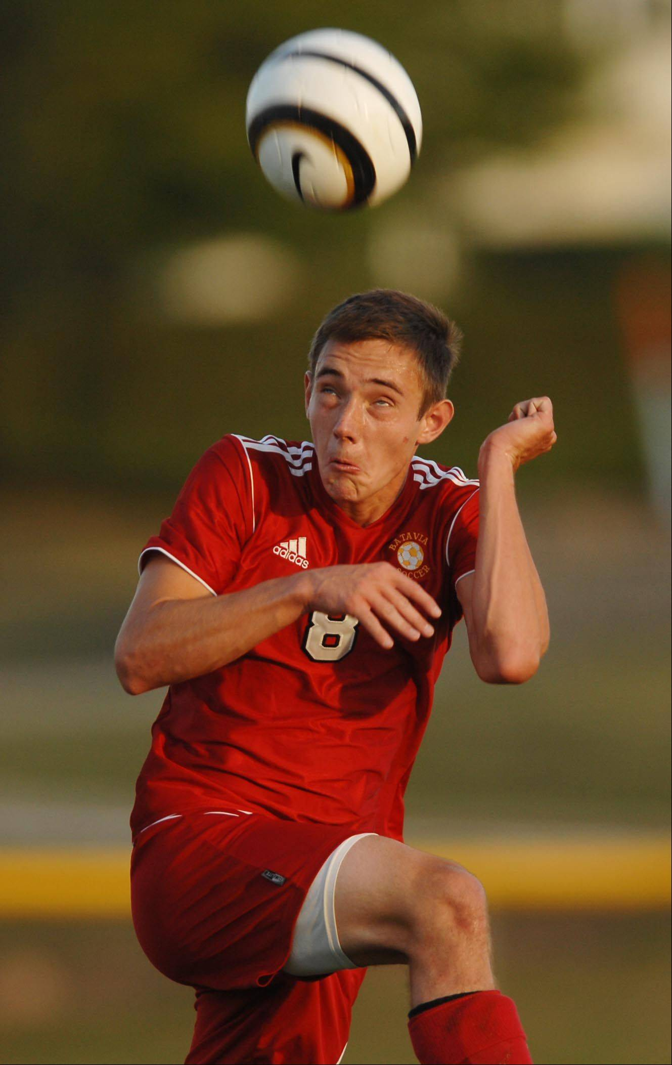 Batavia's Brendan Allen controls the high ball Thursday against St. Charles East in St. Charles.