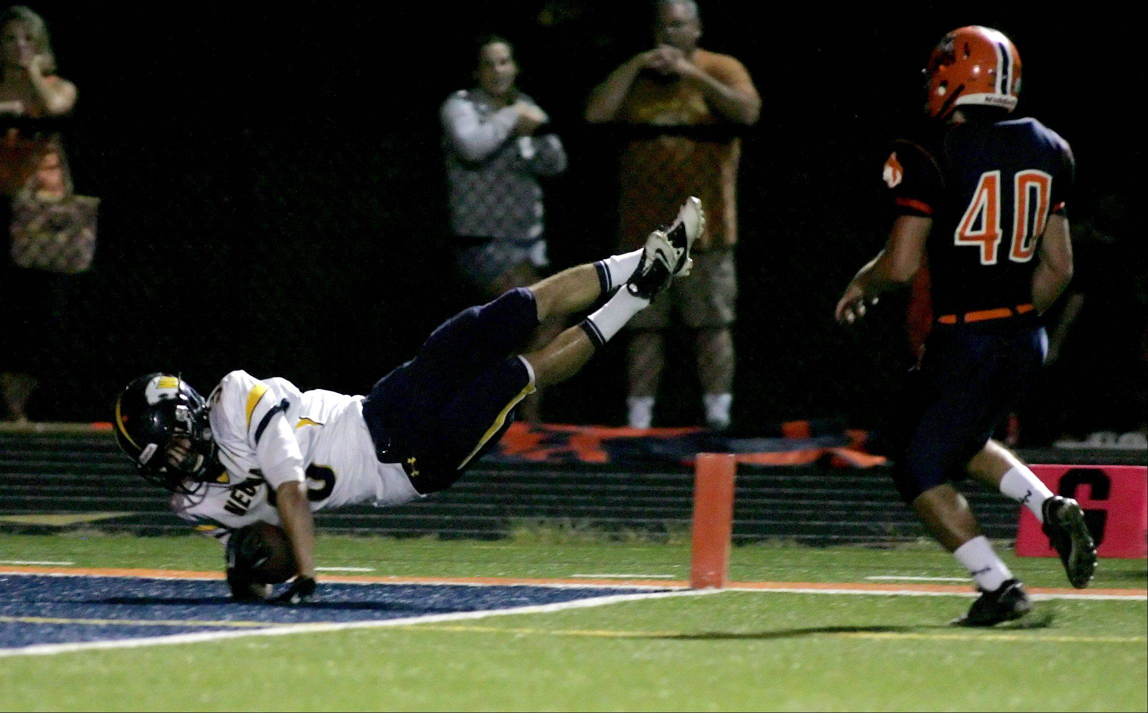 Neuqua Valley's Mikey Dudek dives for a touchdown in football action Friday against Naperville North.