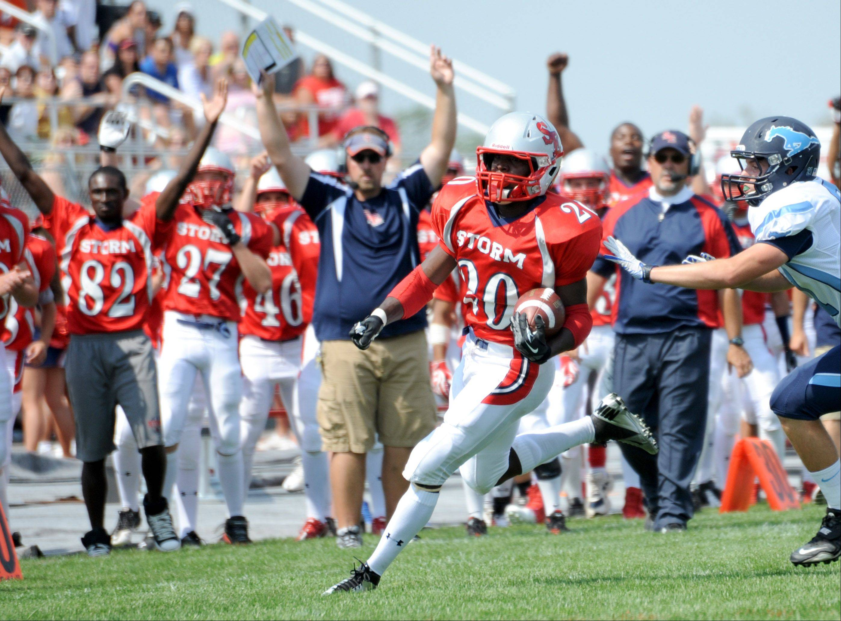 South Elgin running back Jeff Broger turns the corner on a long run against Downers Grove South Saturday in South Elgin.
