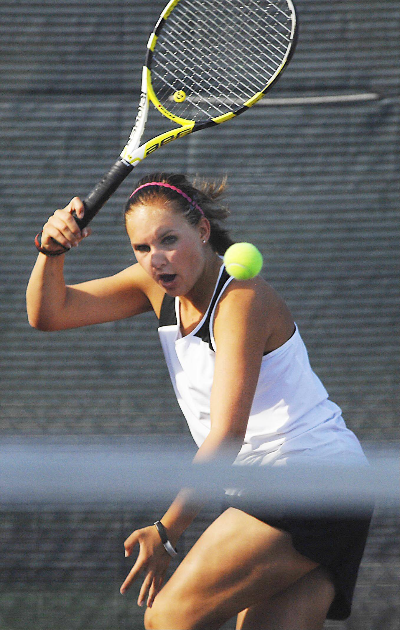 Kaneland's Samantha Schrepferman plays Wheaton Academy's Lexi Welton Wednesday in Maple Park.
