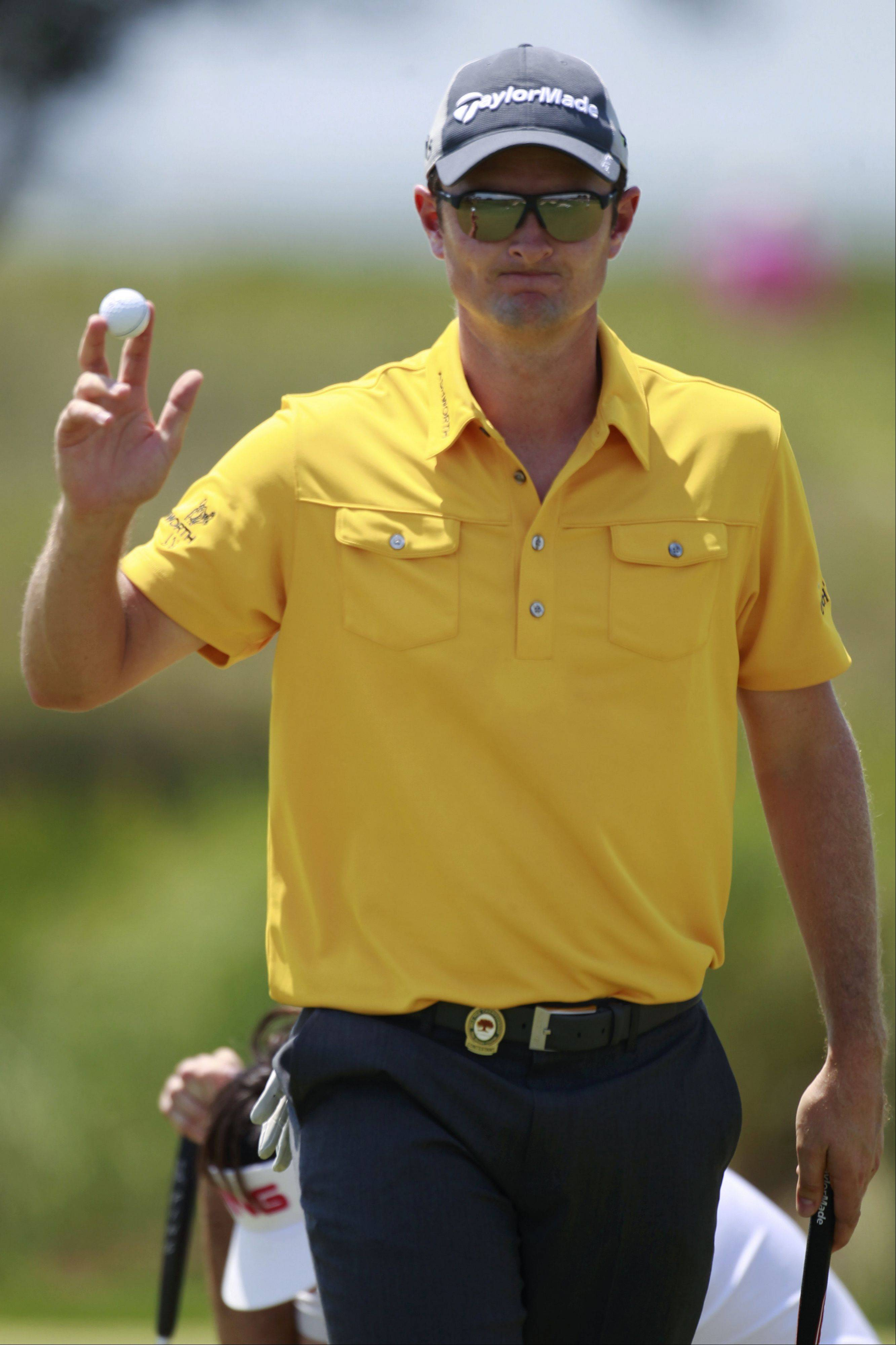 Justin Rose, of England, waves to the gallery after putting on the second green during the final round of the PGA Championship golf tournament on the Ocean Course of the Kiawah Island Golf Resort in Kiawah Island, S.C., Sunday, Aug. 12, 2012.