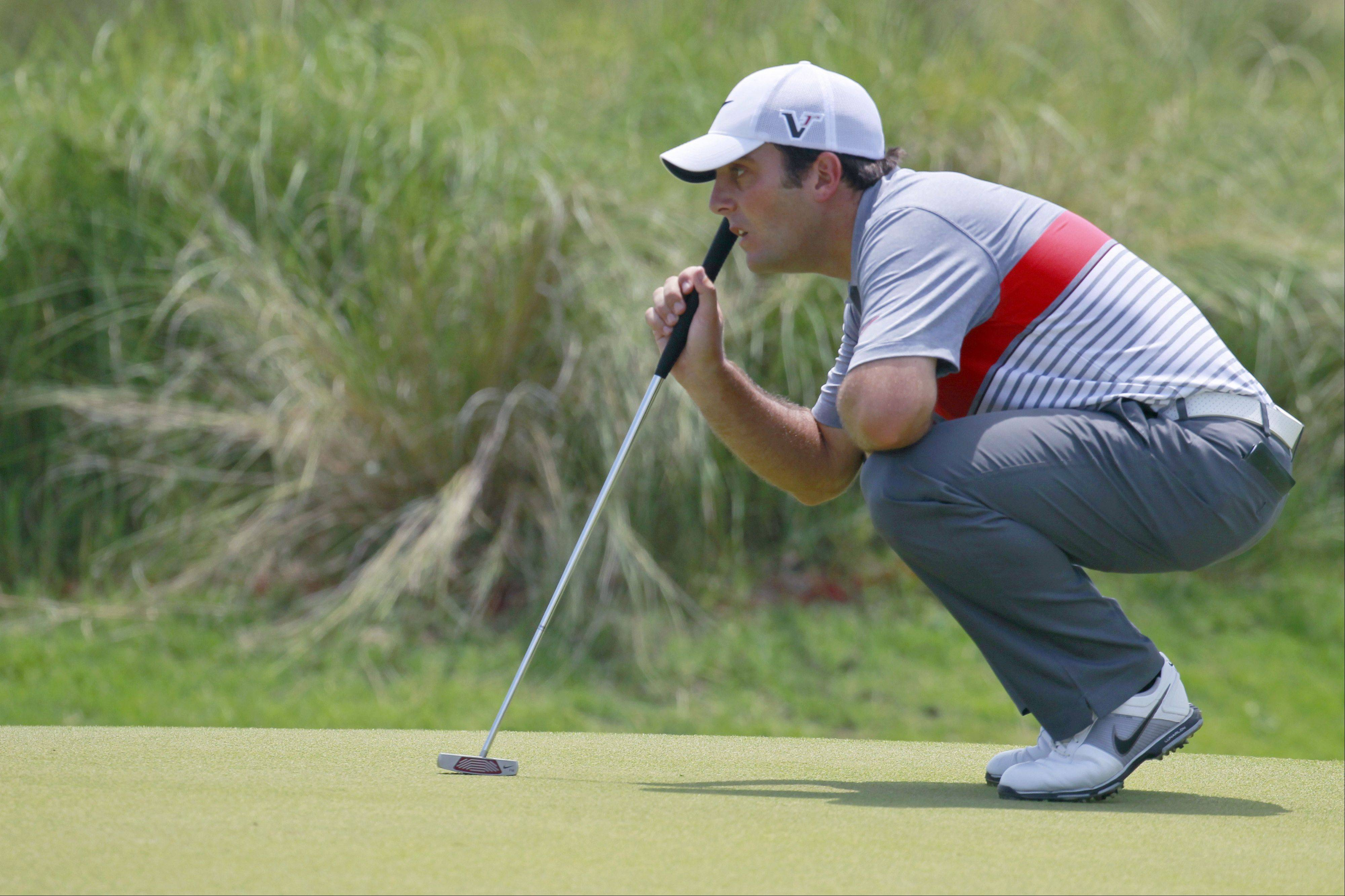 Francesco Molinari of Italy lines up his putt on the second hole during the third round of the PGA Championship golf tournament on the Ocean Course of the Kiawah Island Golf Resort in Kiawah Island, S.C., Saturday, Aug. 11, 2012.