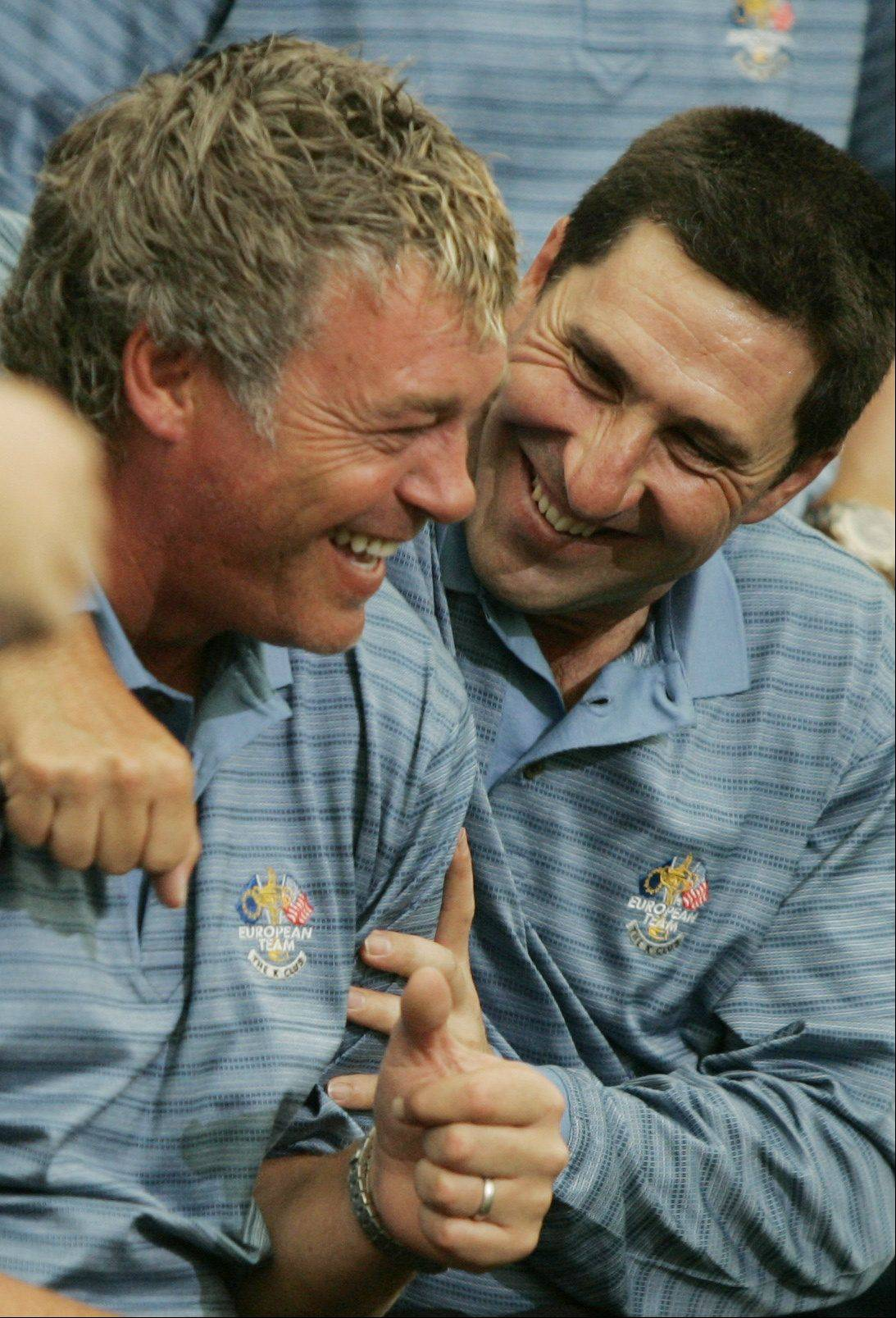 European Ryder Cup team player Darren Clarke, left, is hugged by teammate Jose Maria Olazabal during a photo call for the team at the K Club golf course, Straffan, Ireland, Thursday Sept. 21, 2006. Clarke, hero of the 2006 Cup for the Europeans, lost his wife shortly before the 2006 Cup,