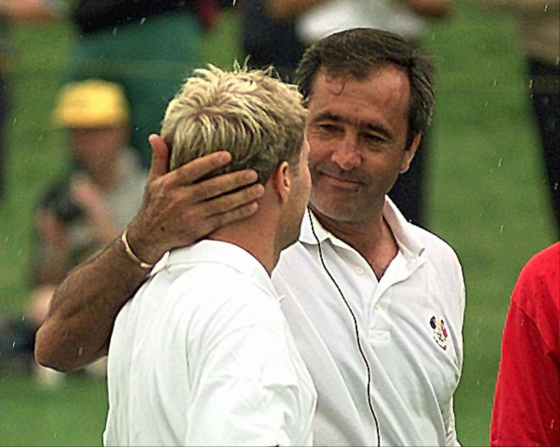 "European Ryder Cup team captain Severiano Ballesteros of Spain, right, congratulates Per-Ulrik Johansson of Sweden after he defeated Davis Love III of the United States team by 3 and 2 during their singles match on the final day of the Ryder Cup at Valderrama golf course, southern Spain Sunday Sept. 28, 1997. The 1997 Cup is considered by many to be ""Seve's Ryder Cup"" on account of his impressive play."