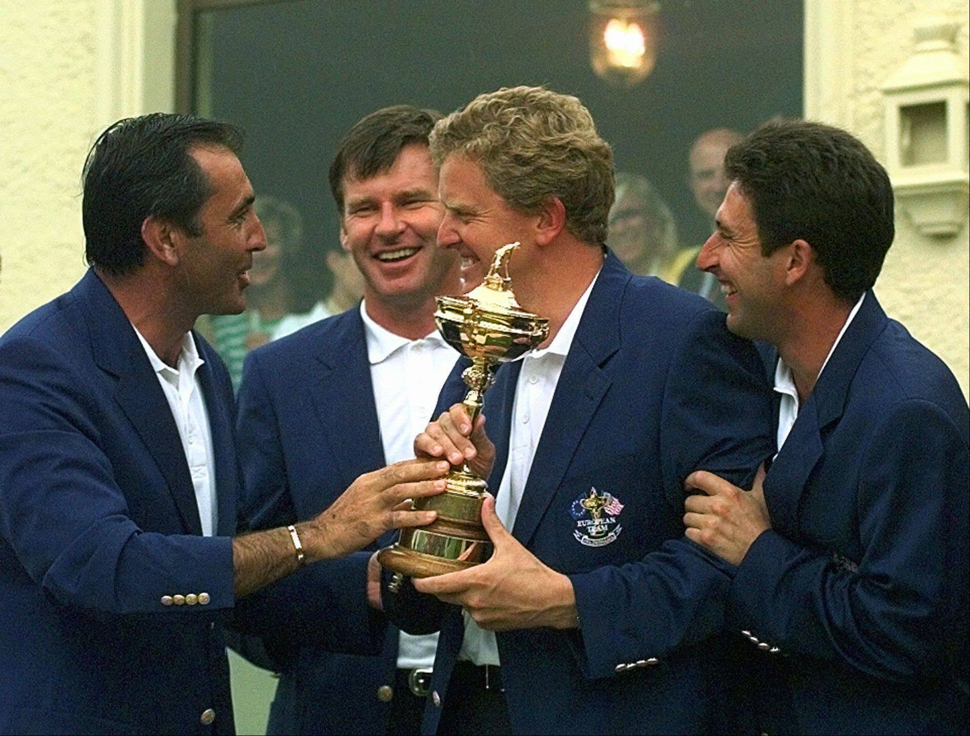 "European Ryder Cup team captain Severiano Ballesteros and players Nick Faldo of England, Colin Montgomerie of Scotland and Jose Maria Olazabal of Spain (left to right) hold the trophy after Europe beat the United States 14 1/2 to 13 1/2 to win the Ryder Cup at Valderrama golf course, southern Spain Sunday Sept. 28, 1997.The 1997 Cup is considered by many to be ""Seve's Ryder Cup"" on account of his impressive play."