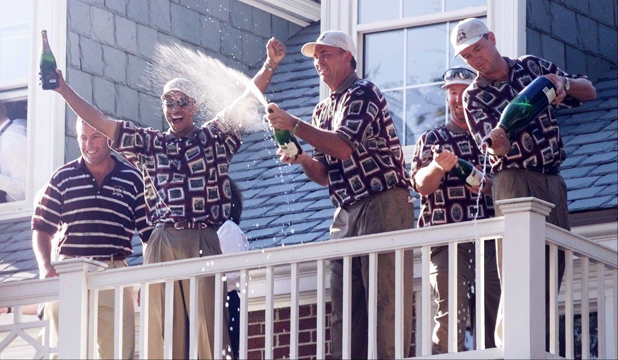 U.S. Ryder Cup team members sprays champagne on the crowd below the clubhouse balcony after winning the Ryder Cup Sunday, Sept. 26, 1999, at The Country Club in Brookline, Mass. The Americans were criticized for excessive celebration in reaction of their 1999 victory.