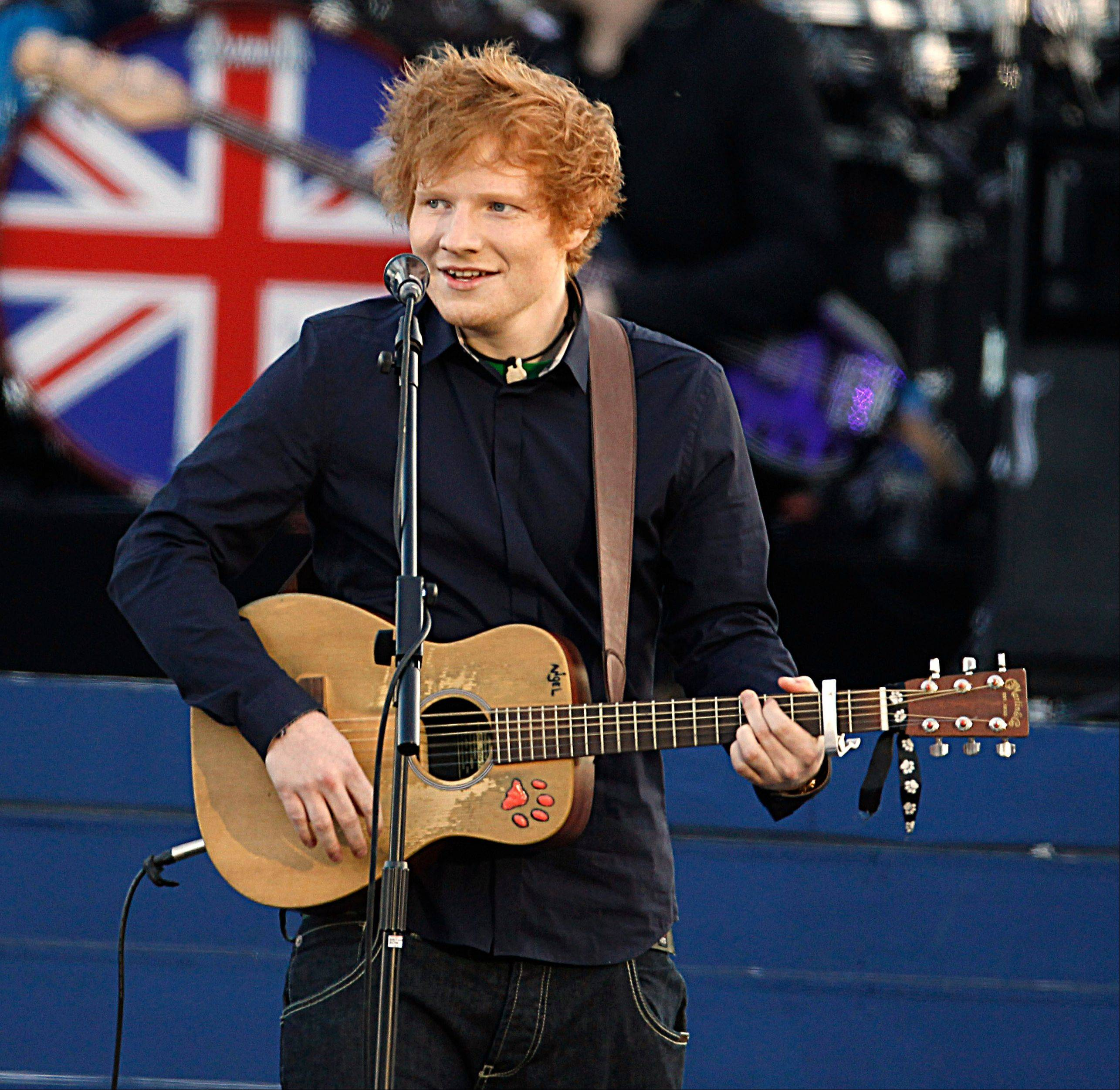 Ed Sheeran performs at the Queen�s Jubilee Concert in front of Buckingham Palace in London. Sheeran, who wrote the pop ballad �Moments,� performed by One Direction, recently wrote and recorded songs with Taylor Swift for her upcoming fourth album.