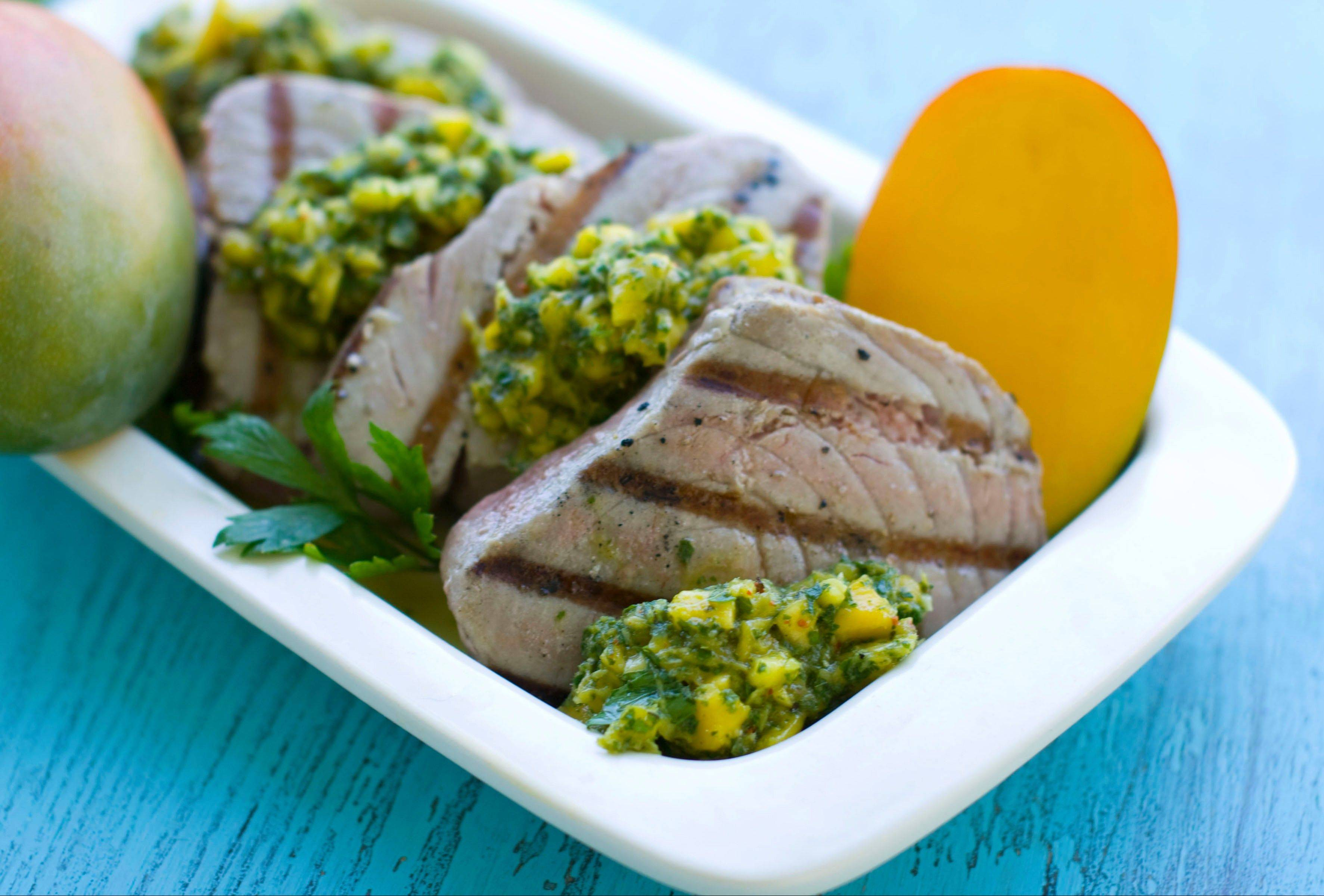 Send summer out with the big, bold flavors of Grilled Tuna Steaks with Mango Herb Salsa.