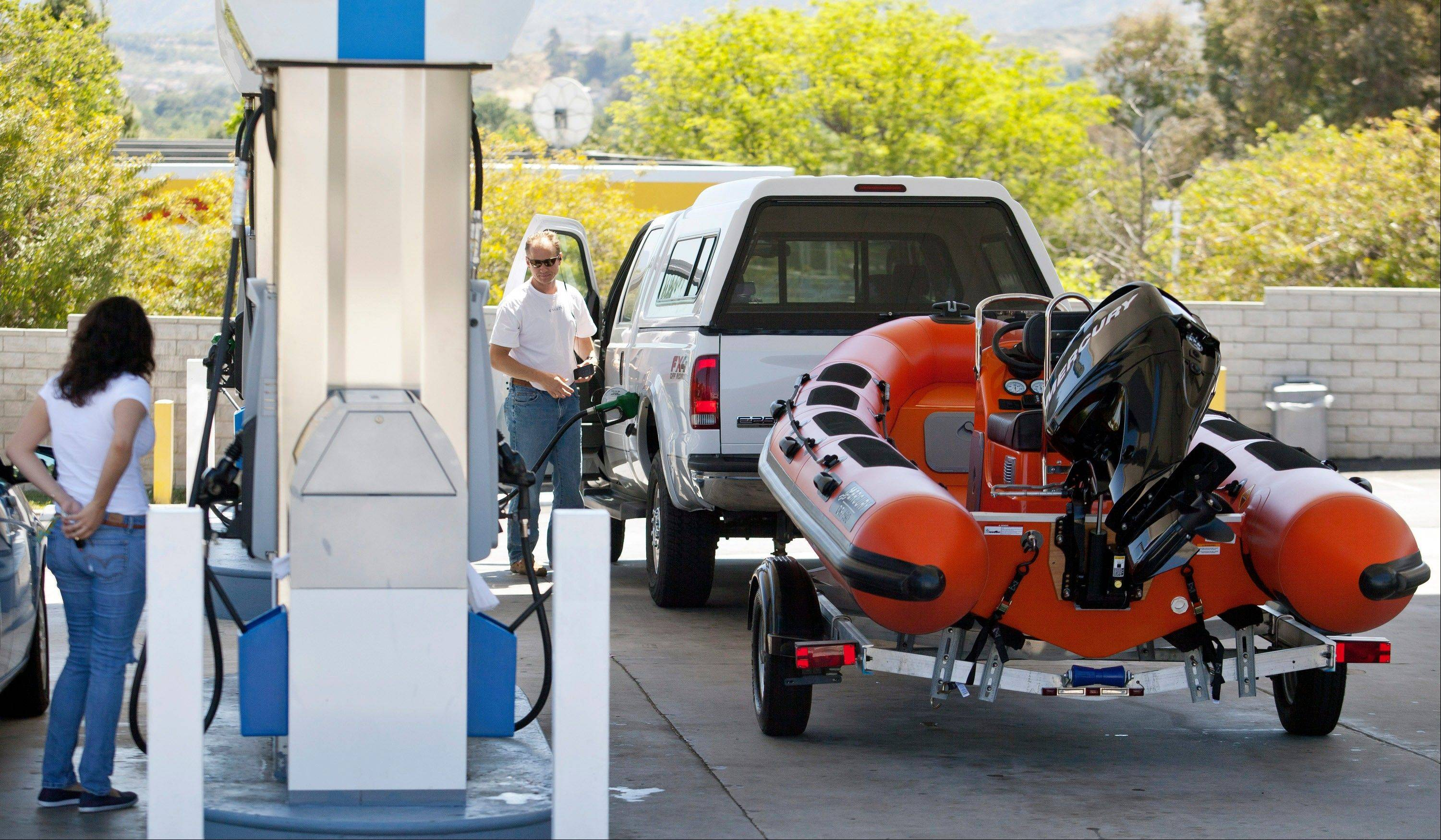 Daily Herald file photo High gas prices may put a cramp in some vacationers' style this Labor Day weekend.