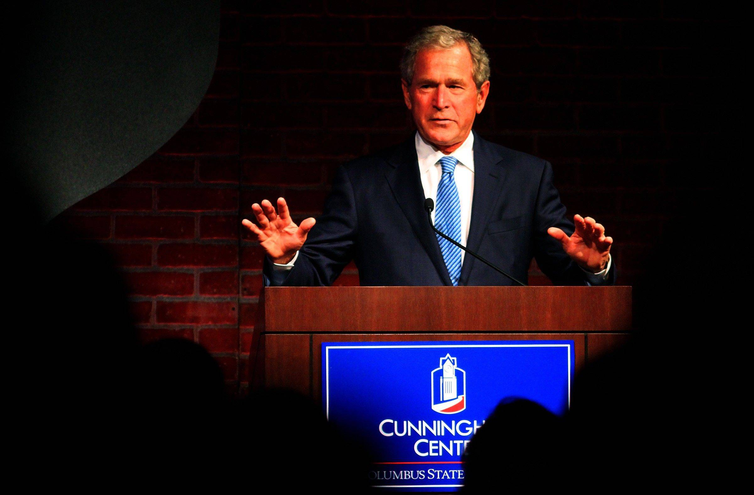 Former President George W. Bush begins his speech, Monday during the annual Jim Blanchard Leadership Forum at the Columbus Convention and Trade Center in Columbus, Ga.