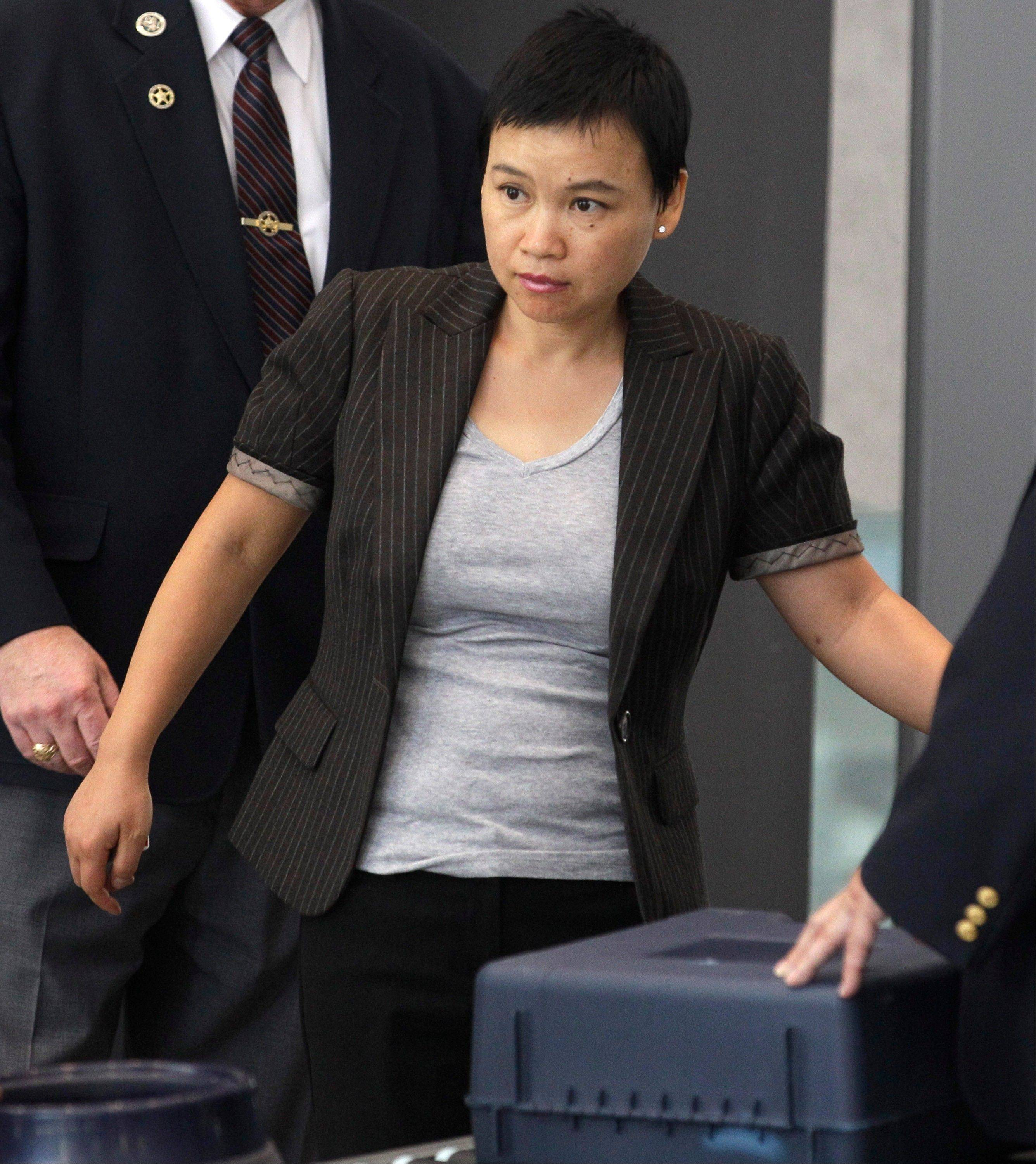Hanjuan Jin enters the federal courthouse Wednesday in Chicago before being sentenced to four years in prison for stealing trade secrets from Motorola.
