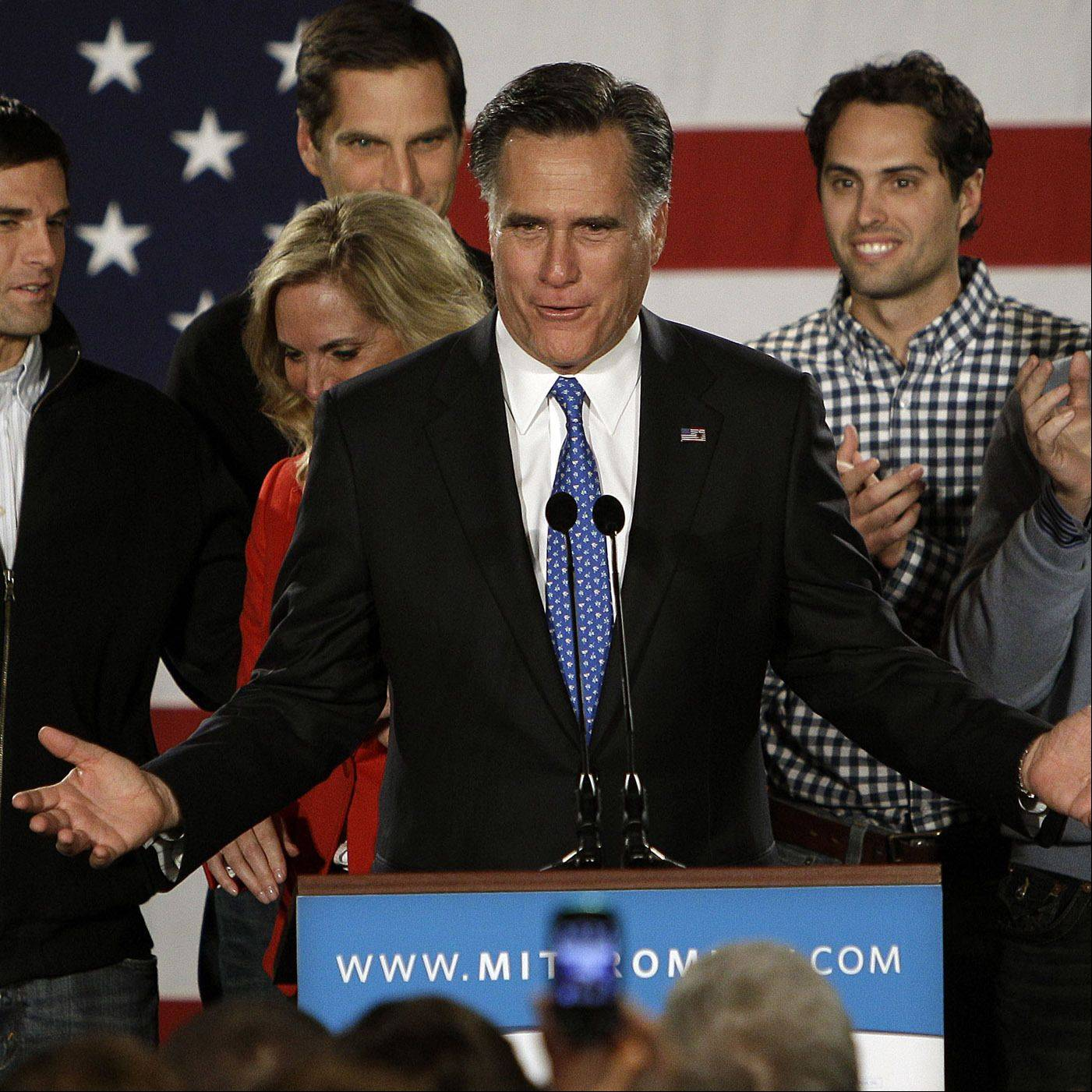 Mitt Romney addresses with his family behind him during a Romney for President Iowa Caucus night rally in Des Moines, Iowa, Tuesday, Jan. 3, 2012.