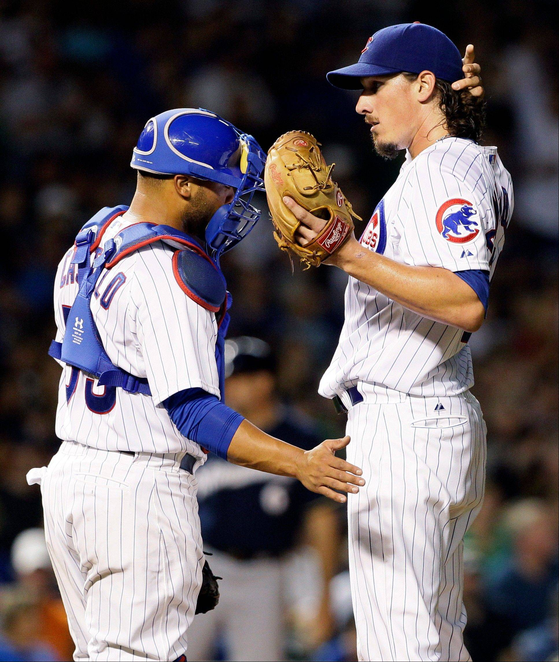 Chicago Cubs starter Jeff Samardzija, right, talks with catcher Welington Castillo during the seventh inning of a baseball game against the Milwaukee Brewers in Chicago, Wednesday.