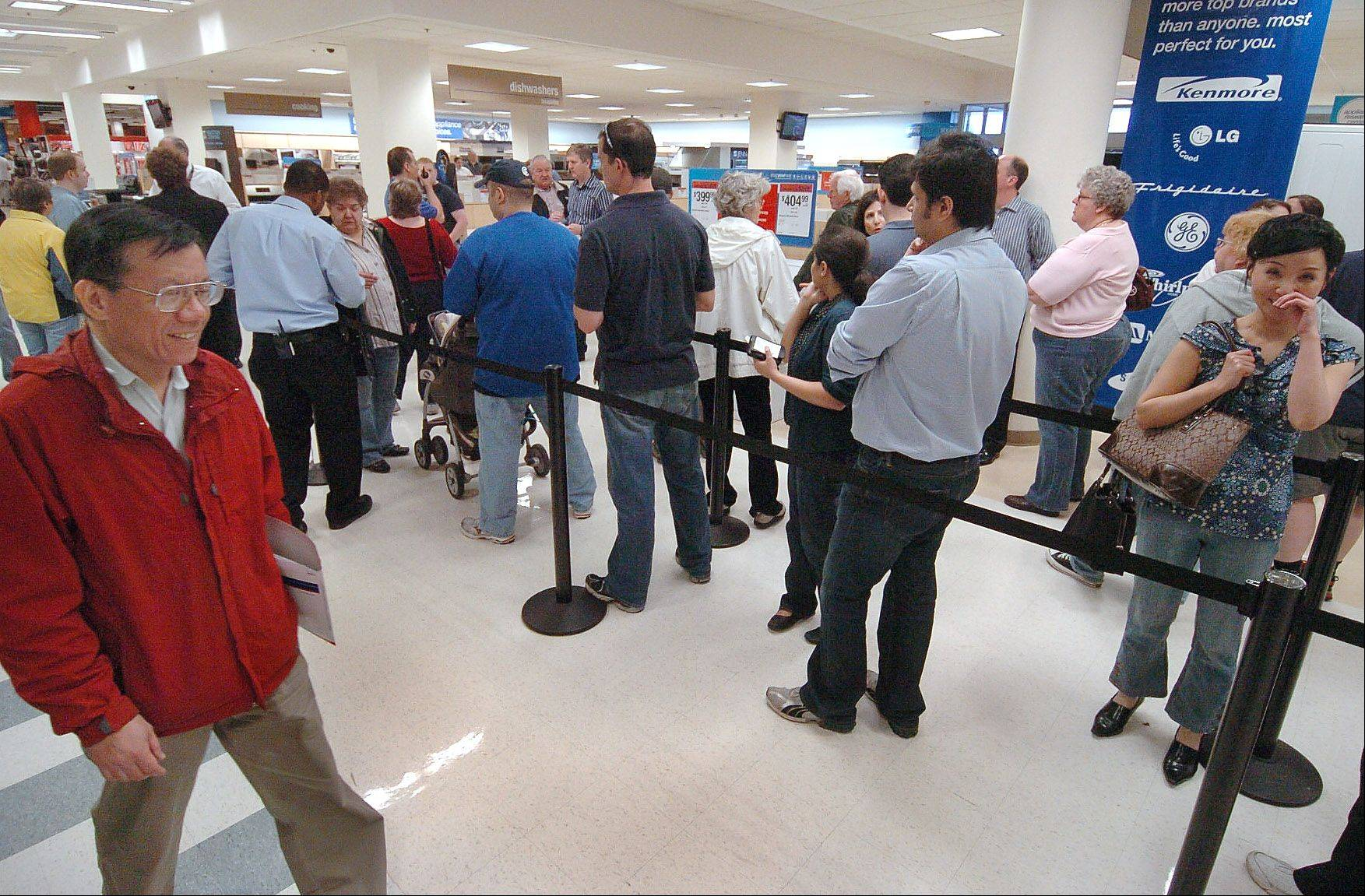 People line up to buy appliances at the Sears at Woodfield.