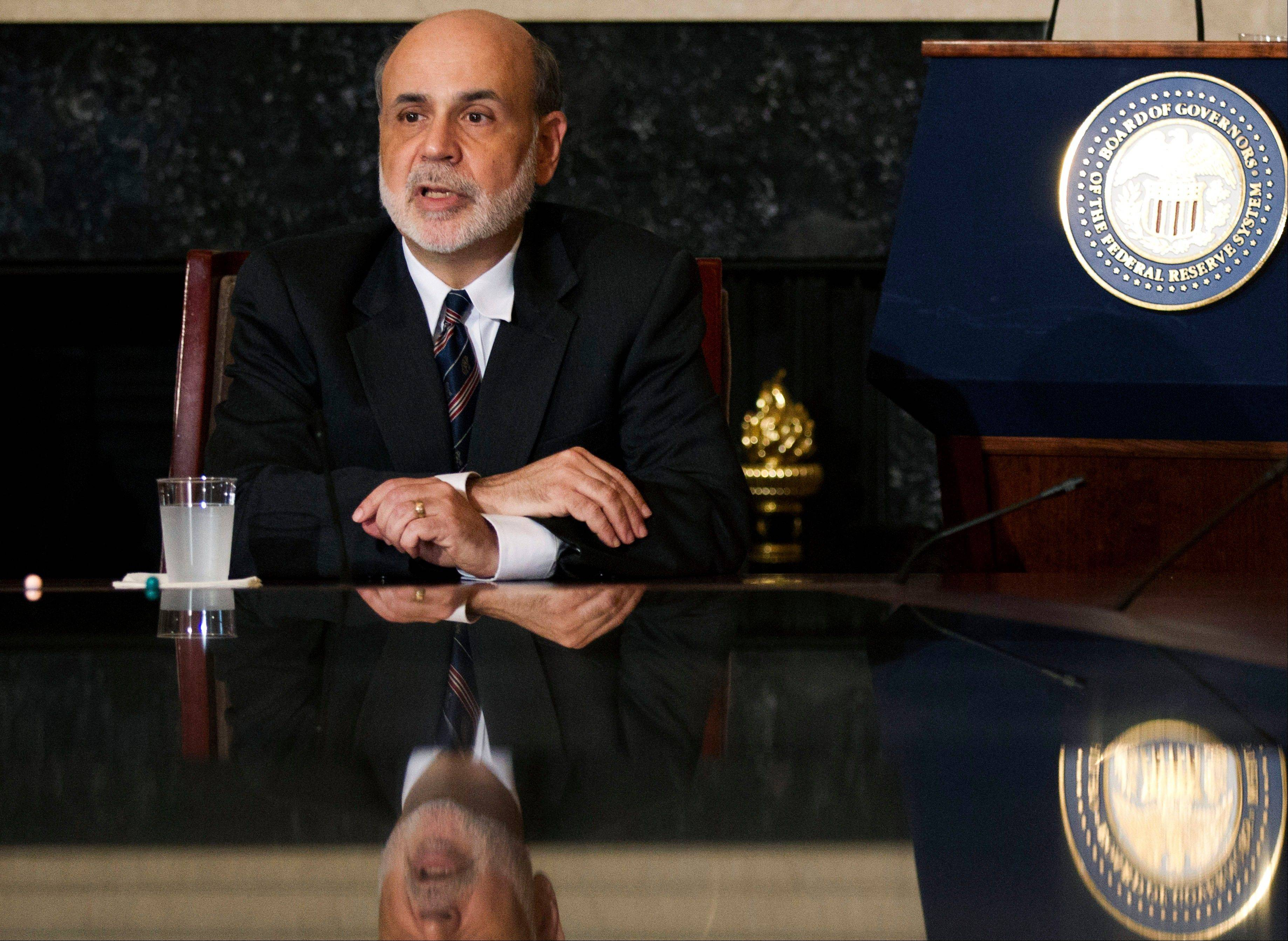 Investors are at least hoping Federal Reserve Chairman Ben Bernanke, above, at least hints Friday the Federal Reserve is ready to launch another round of bond purchases to try to lower long-term U.S. interest rates and spur more borrowing and spending.