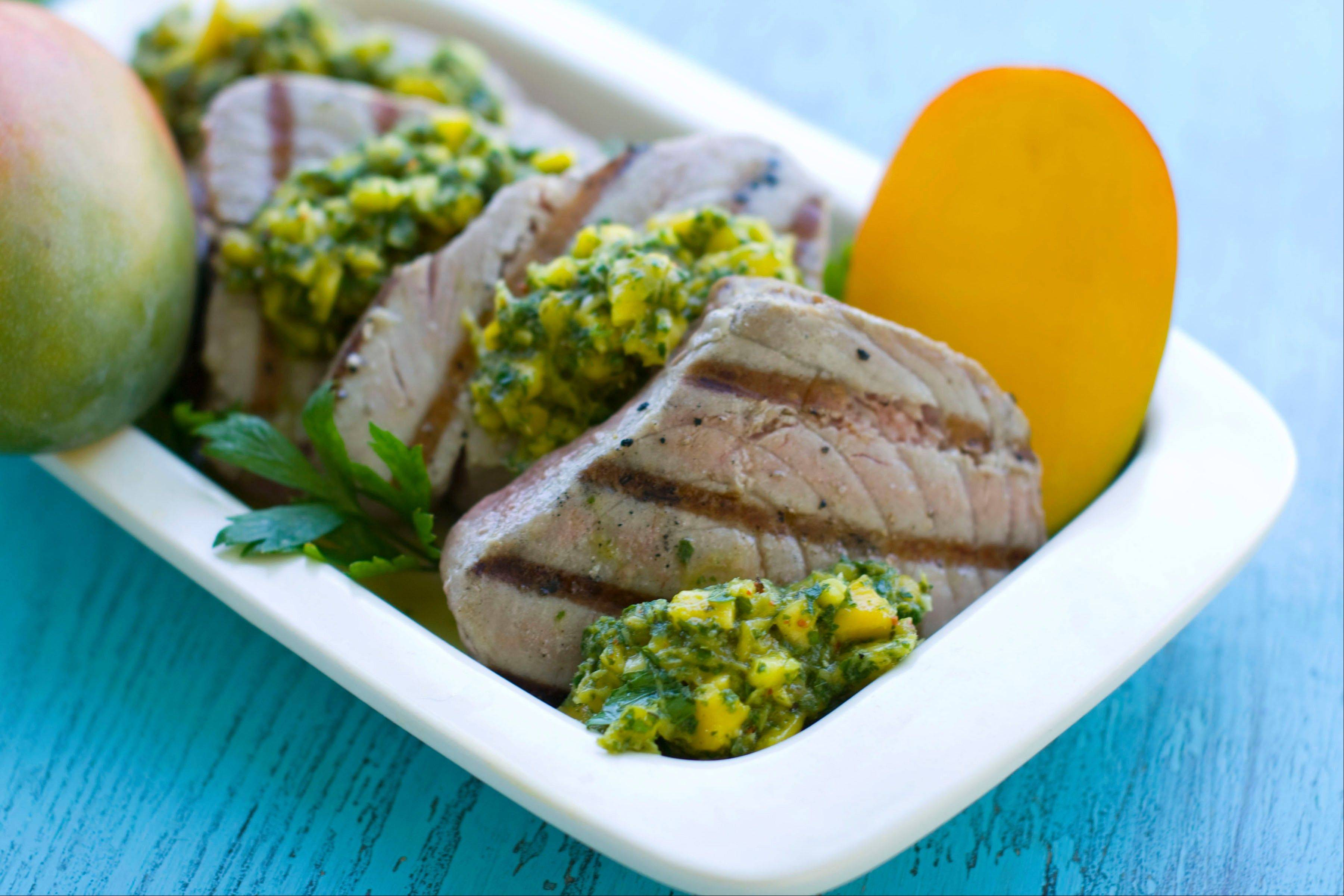 Send summer out with the big, bold flavor of Grilled Tuna Steaks with Mango Herb Salsa.
