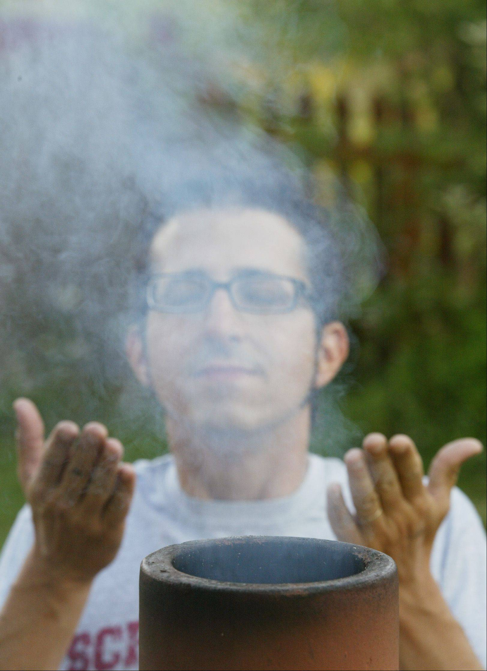 Cook of the Week Challenge entrant Michael Pennisi of Carpentersville, with his favorite ingredient -- smoke.