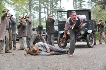 "Jack (Shia LaBeouf), charges law officers during a highway skirmish in the Prohibition-era crime drama ""Lawless,"" based on a family history."