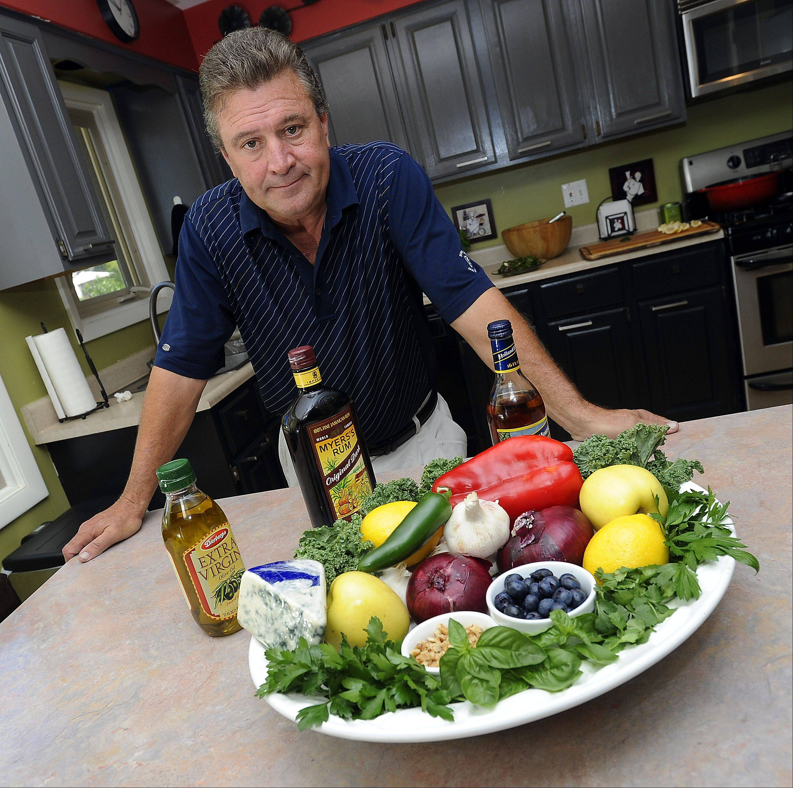 Mark Welsh/mwelsh@dailyherald.comElk Grove Village Ronald Nunes with his favorite ingredients, onions, peppers, blueberries, preparing to cook his famous pork chops.