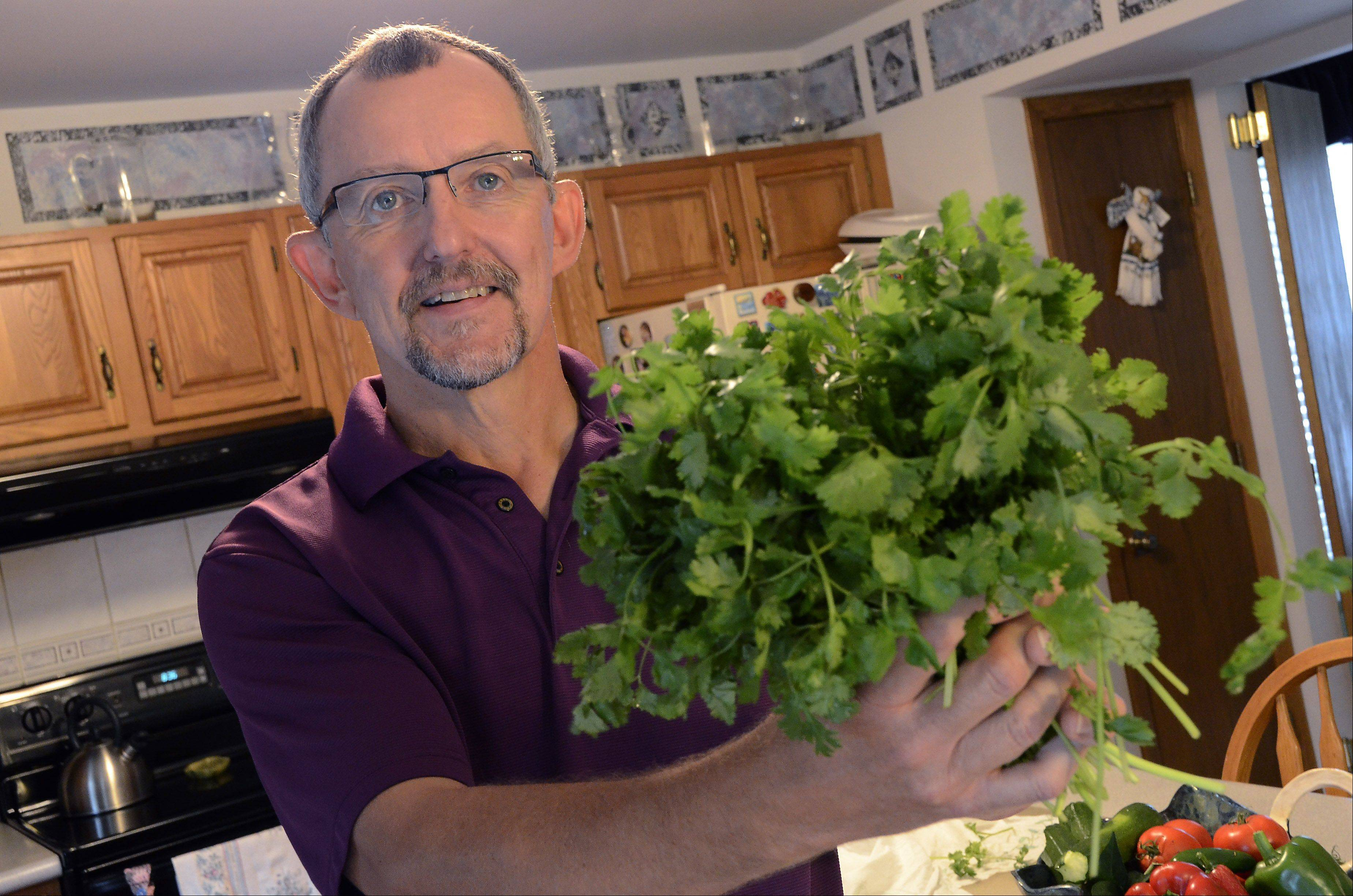 Bill Zars/bzars@dailyherald.comCook of the year contestant Joe Moninski of Arlington Heights likes to use fresh ingredients in his recipes. His favorite item is cilantro.