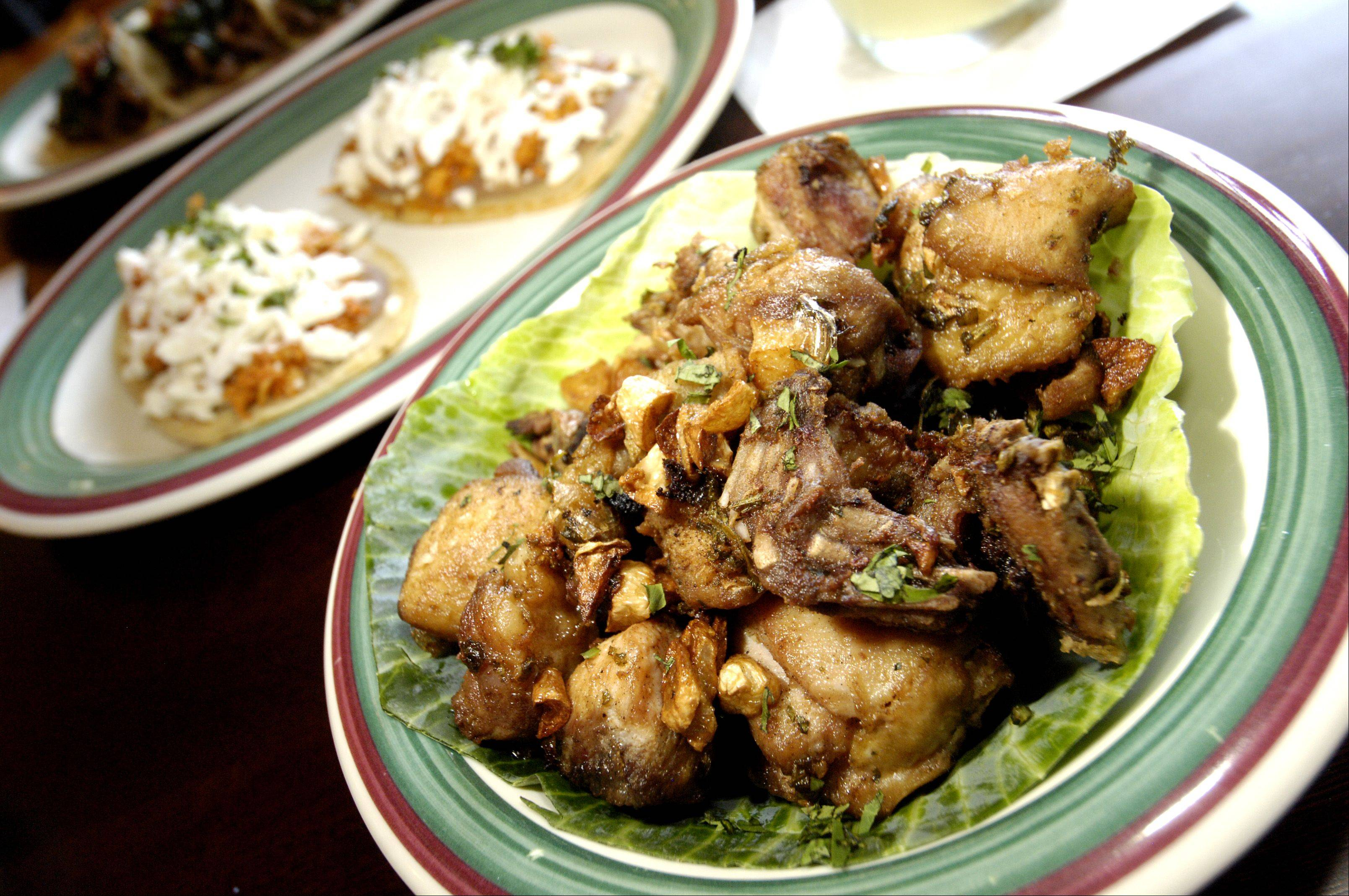 Frango a passarinho is one of the shareable plates available at Changarro, a Mexican-Brazilian restaurant in West Chicago.