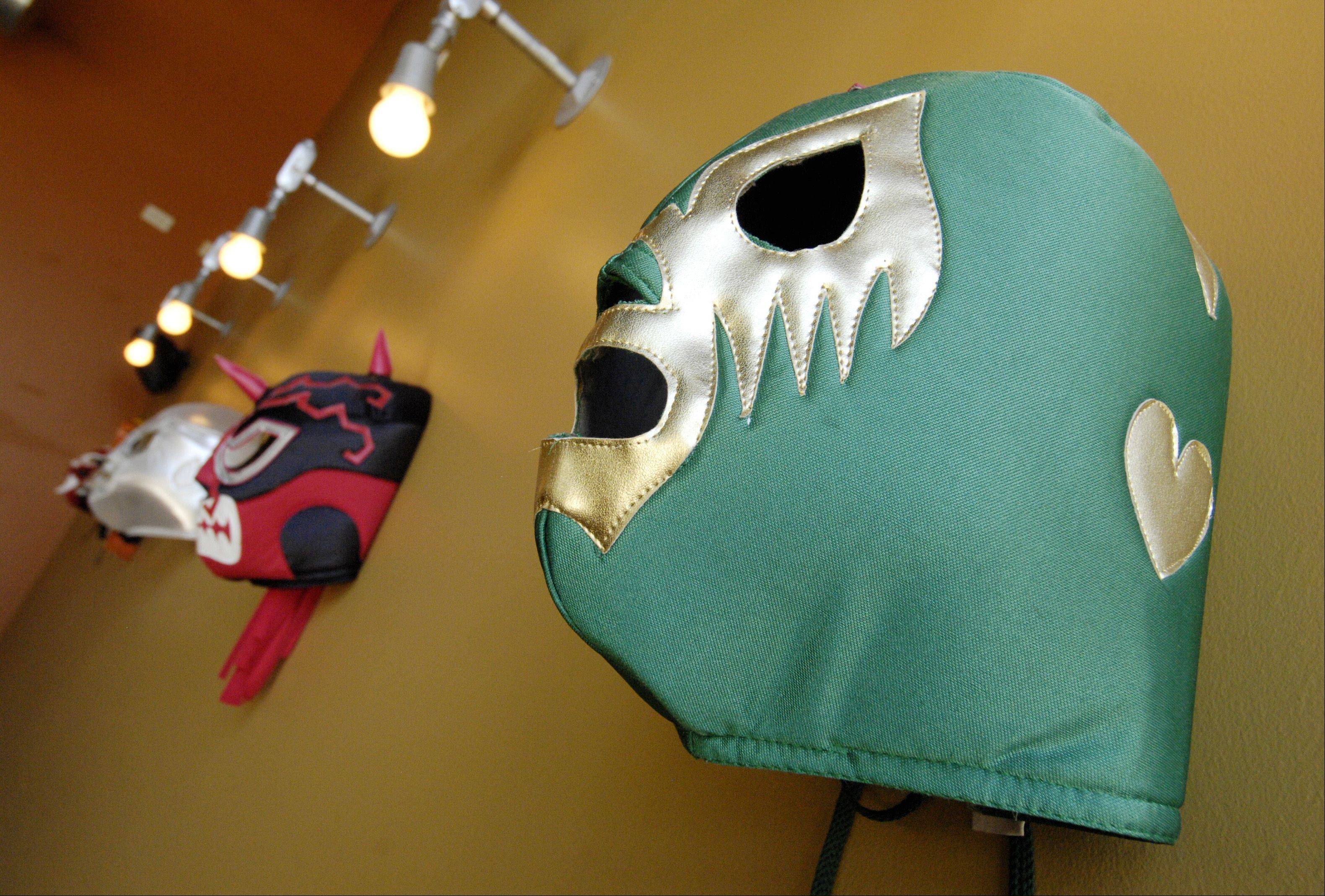 Mexican wrestling masks welcome diners to Changarro in West Chicago.